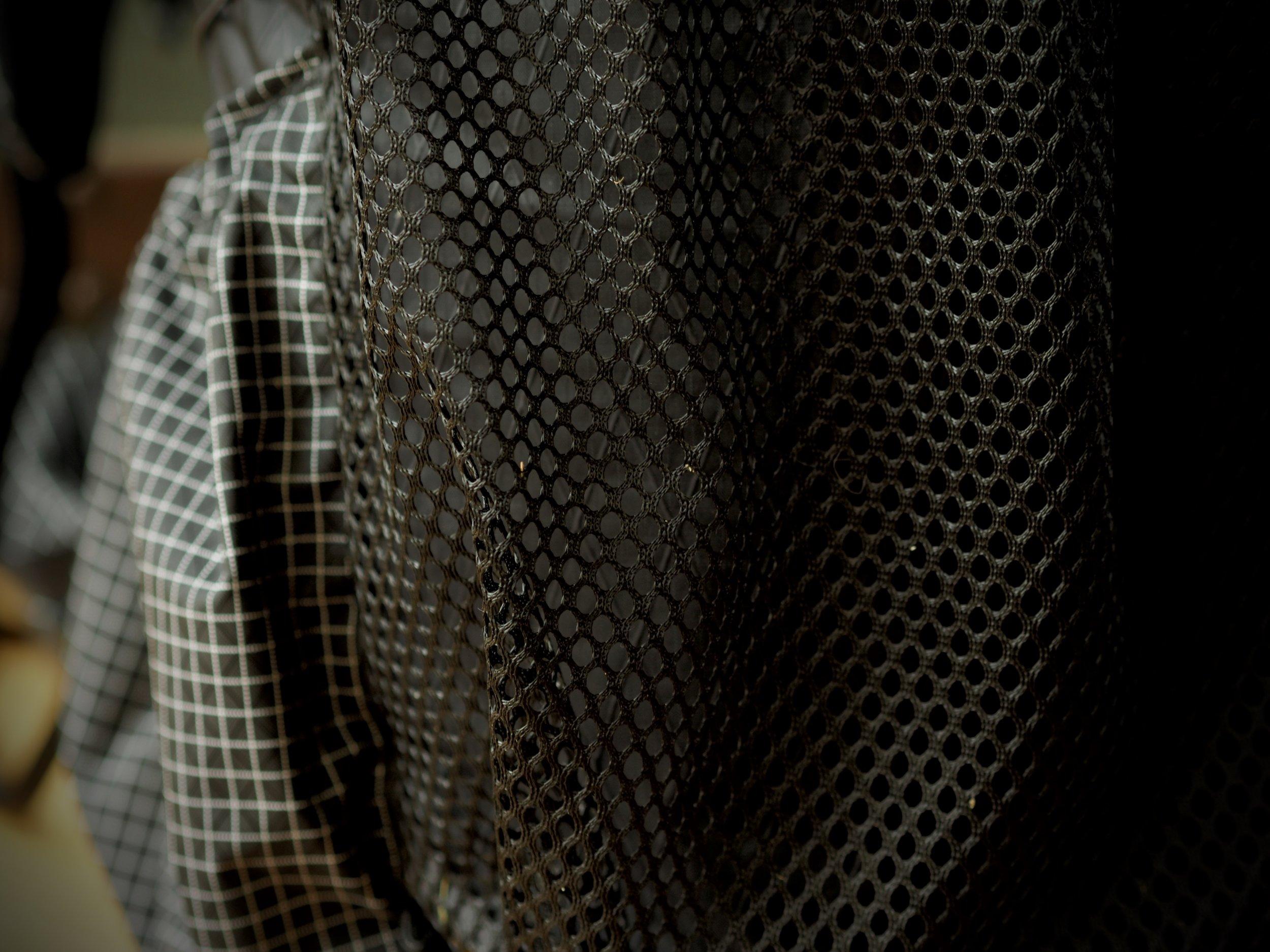 Mesh versus stretch fabric. Far better durability.