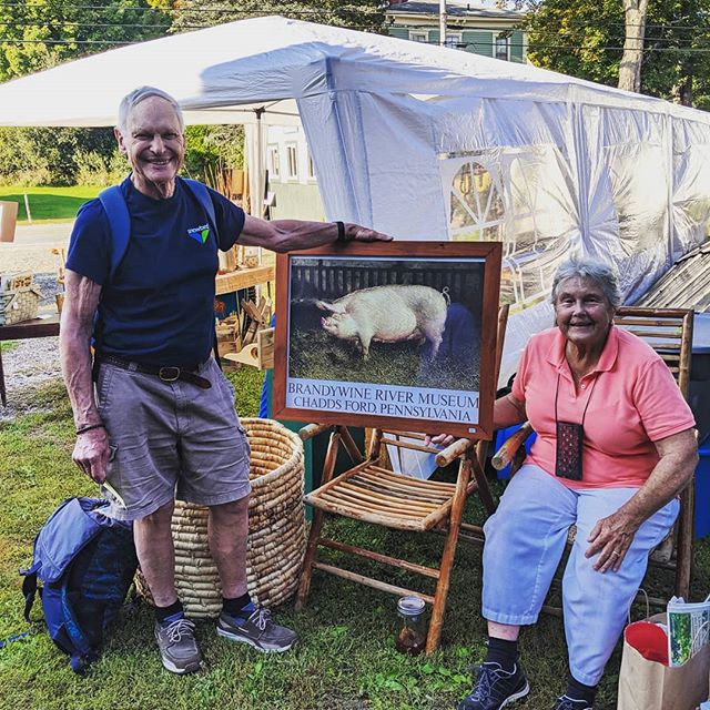 "These are my new friends Phil and Debbie from Cushing. After a long and wonderful day at the fair we were all waiting for the train back to Thorndike and Phil told me about a beautiful Wyeth print of a fine hog he purchased and my reply was ""Hey, I just dragged that out of our attic last night""! We love seeing the items we've collected go home with lovely people."