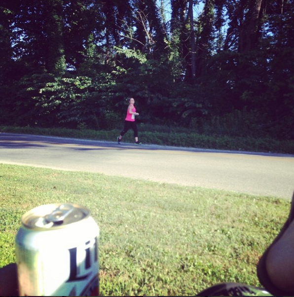 Doug sitting in our front yard propped up with a Miller Lite while I race my 5K.