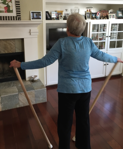 One of my clients, Jennie, working out with the poles.