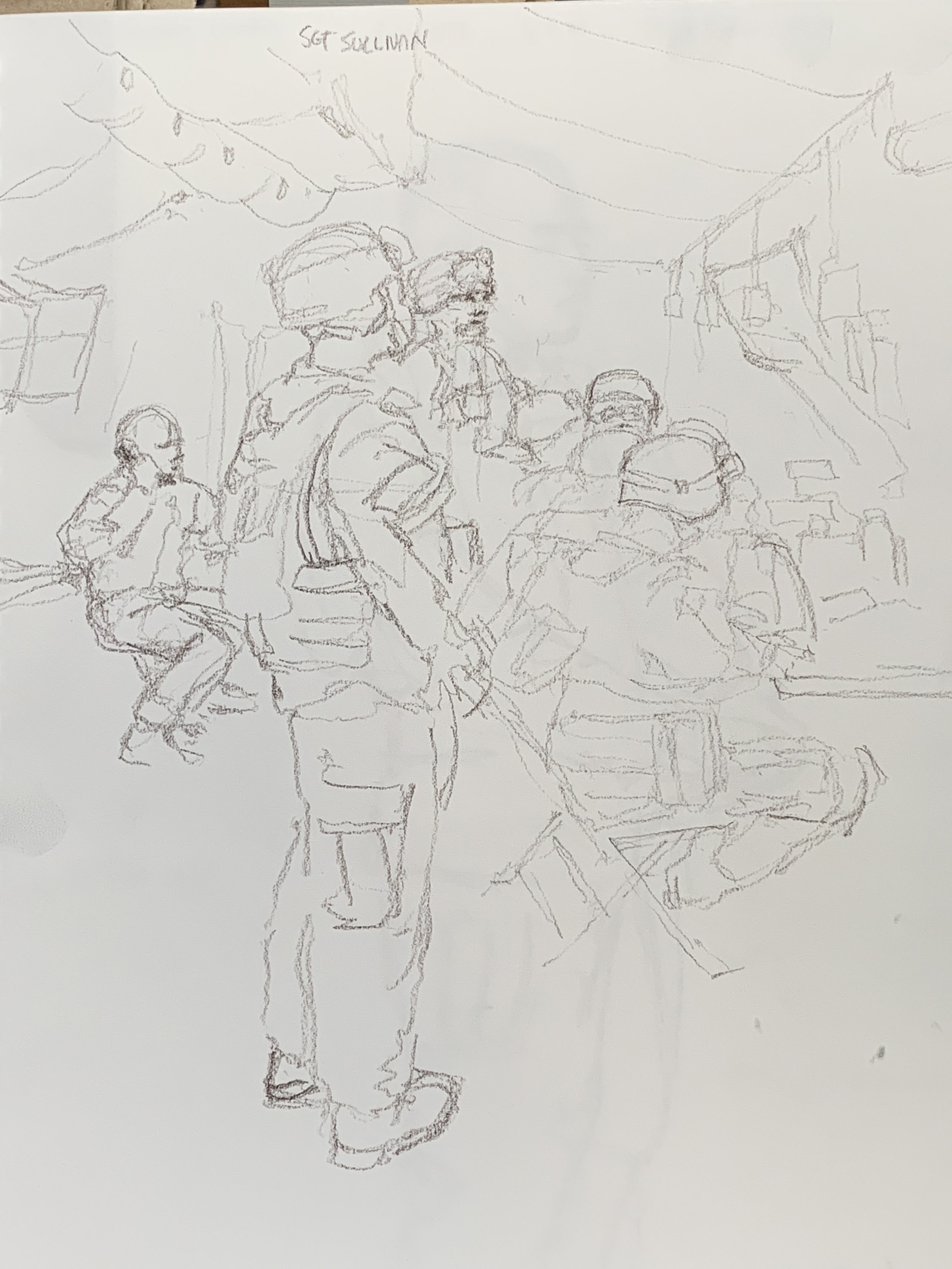 A brief calm moment in the BDoc during a simulated emergency at the airfield.  Helmets and flacks, because an attack on their position was announced.