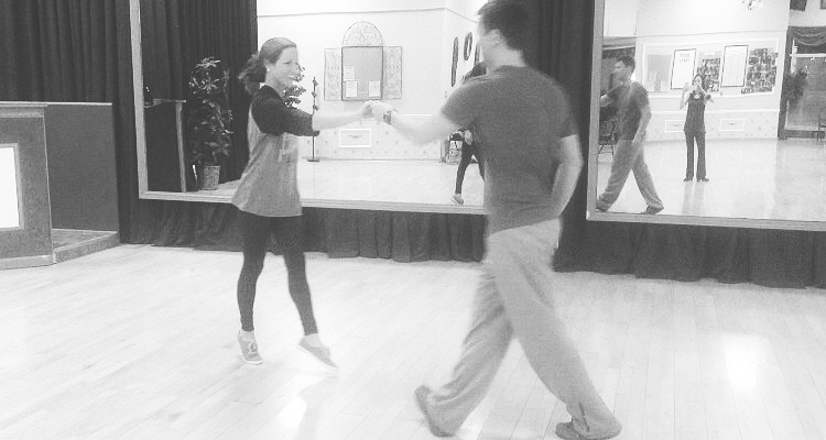 This is a pic of us practicing our dance at the ballroom studio for the last time there the week of the wedding.