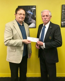 Dr. Graham Elliott, AYPO Executive Director, receiving the first installment of the grant from William Bannon, Foundation Trustee