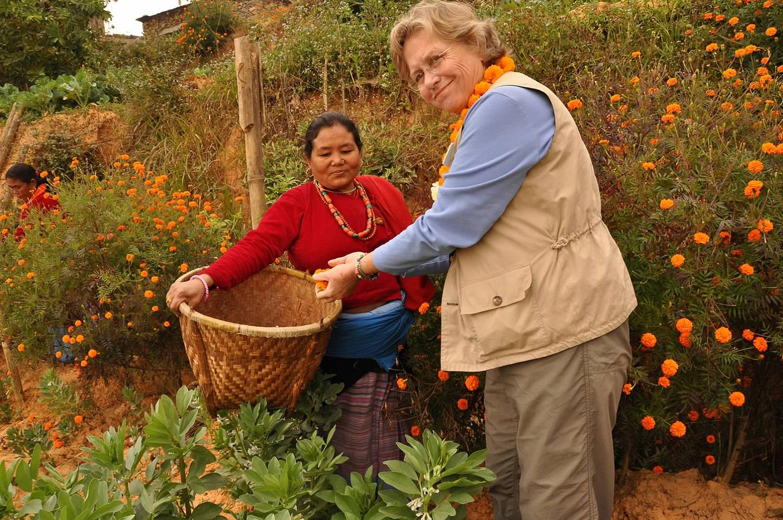 2_Nancy adds her marigolds to the community.jpg