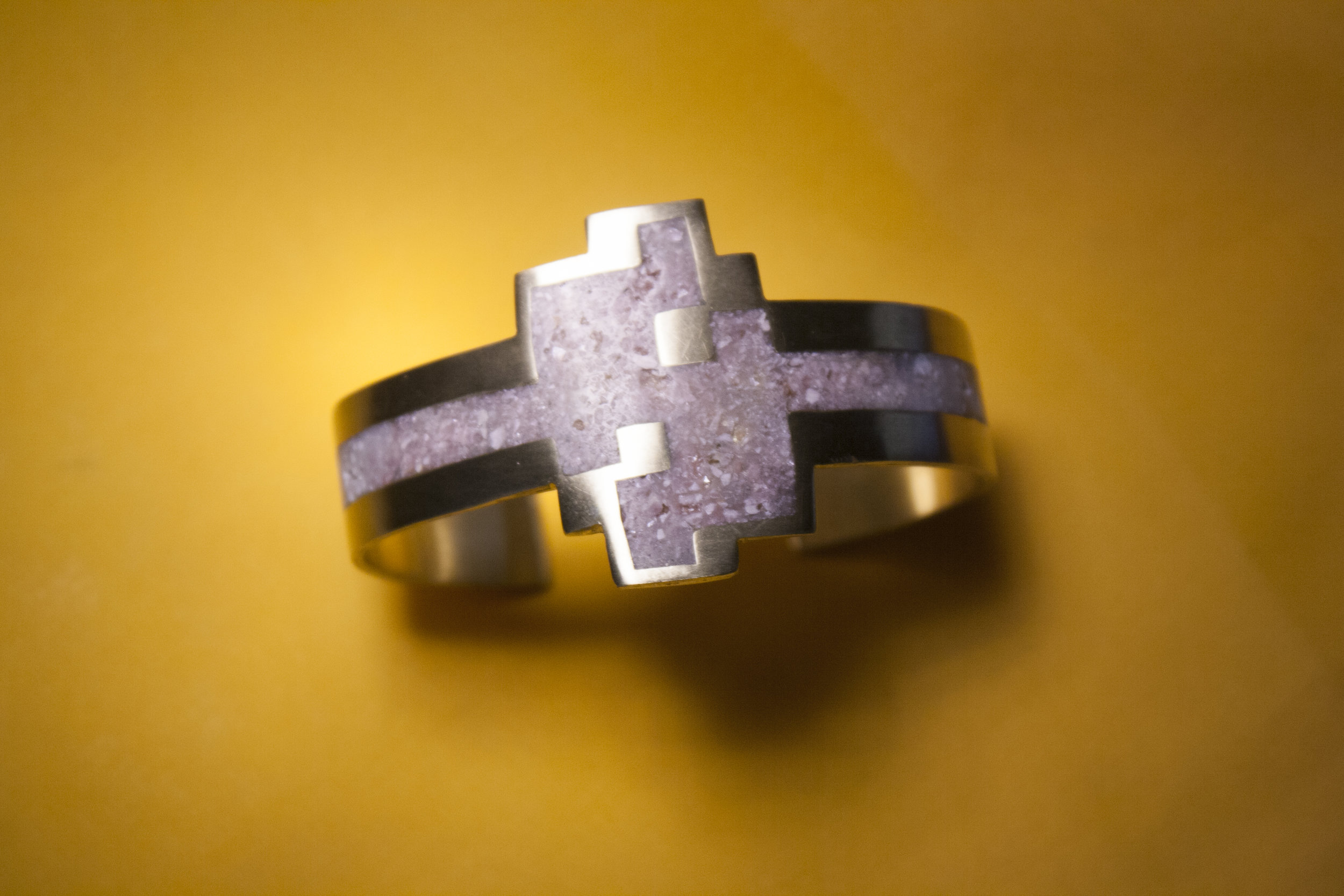 2 layer brass cuff with crushed stone inlay.