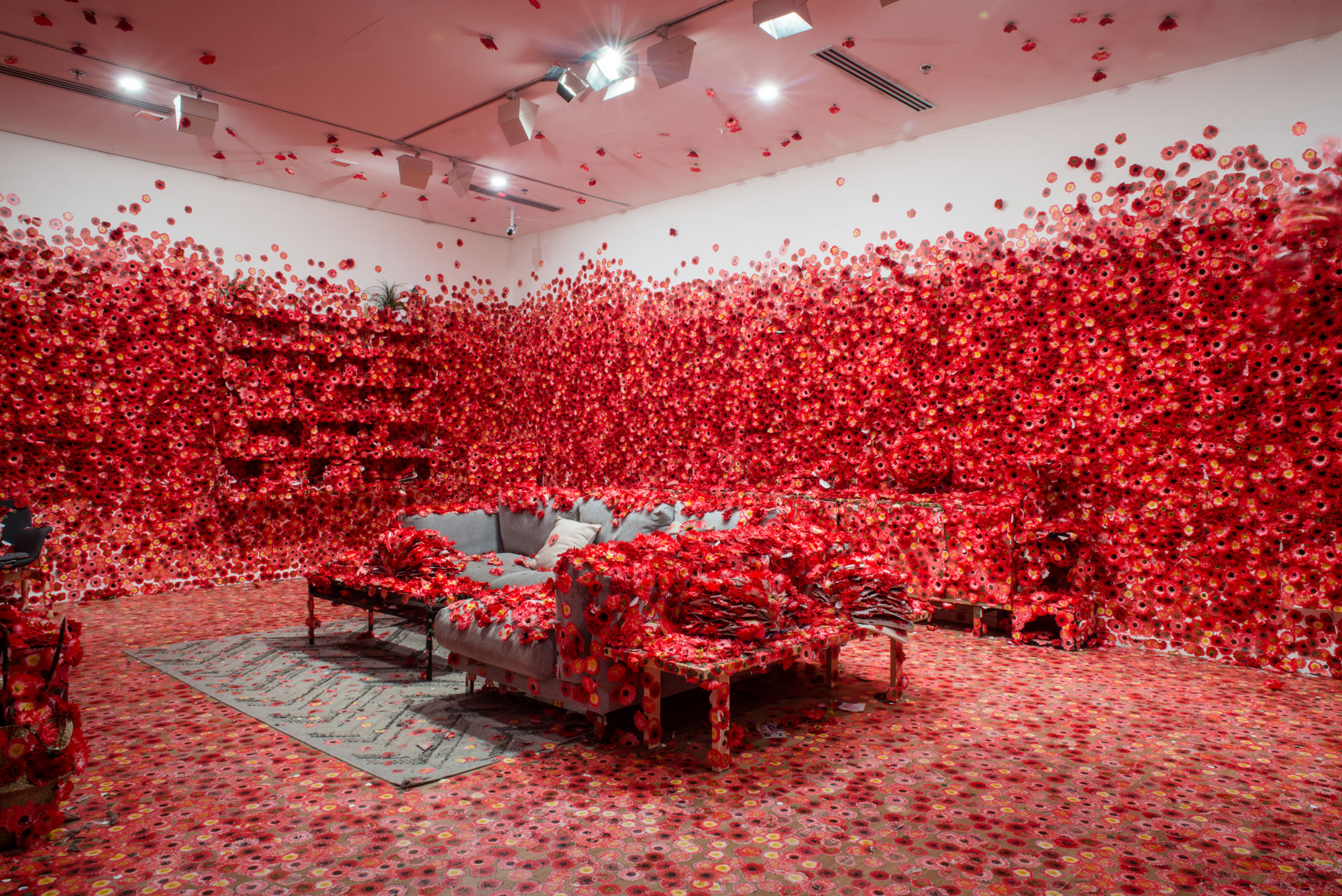 Exhibition image of Yayoi Kusama's Flower Obsession 2017 on display in NGV Triennial at NGV International 2017. Photo: Eugene Hyland
