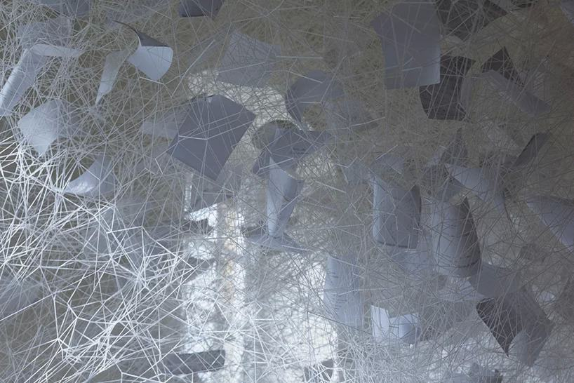 chiharu shiota, beyond time, 2018 | white thread, metal piano, musical notes © VG bild-kunst, bonn, 2018 and the artist, courtesy yorkshire sculpture park | photo © jonty wilde