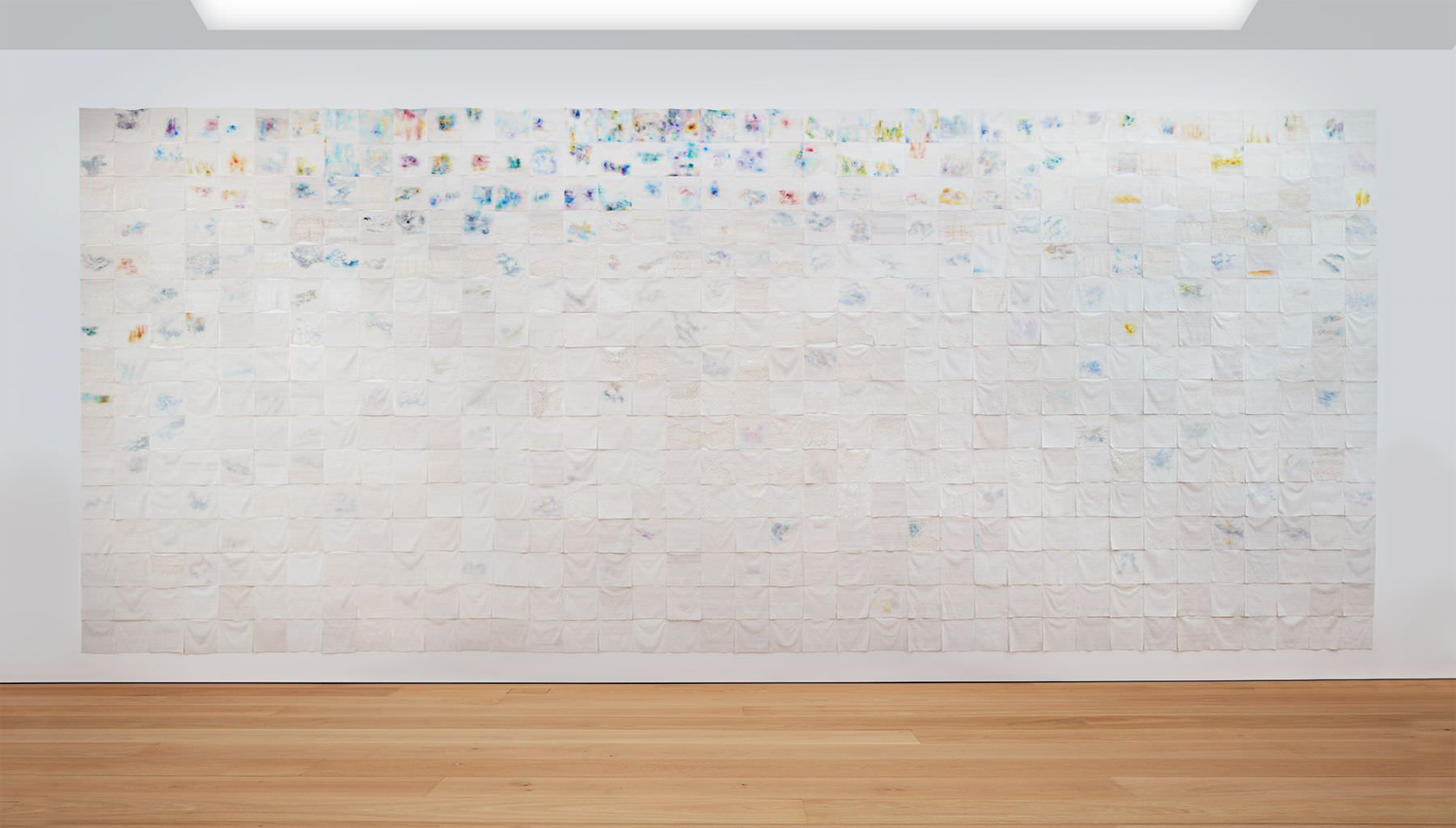 LIZA LOU The Clouds, 2015-2018 site-specific installation of oil paint on woven glass beads and thread on canvas 600 parts, each 35 x 35 cm; Courtesy the artist and Lehmann Maupin, New York, Hong Kong, and Seoul. Photo: Matthew Herrmann