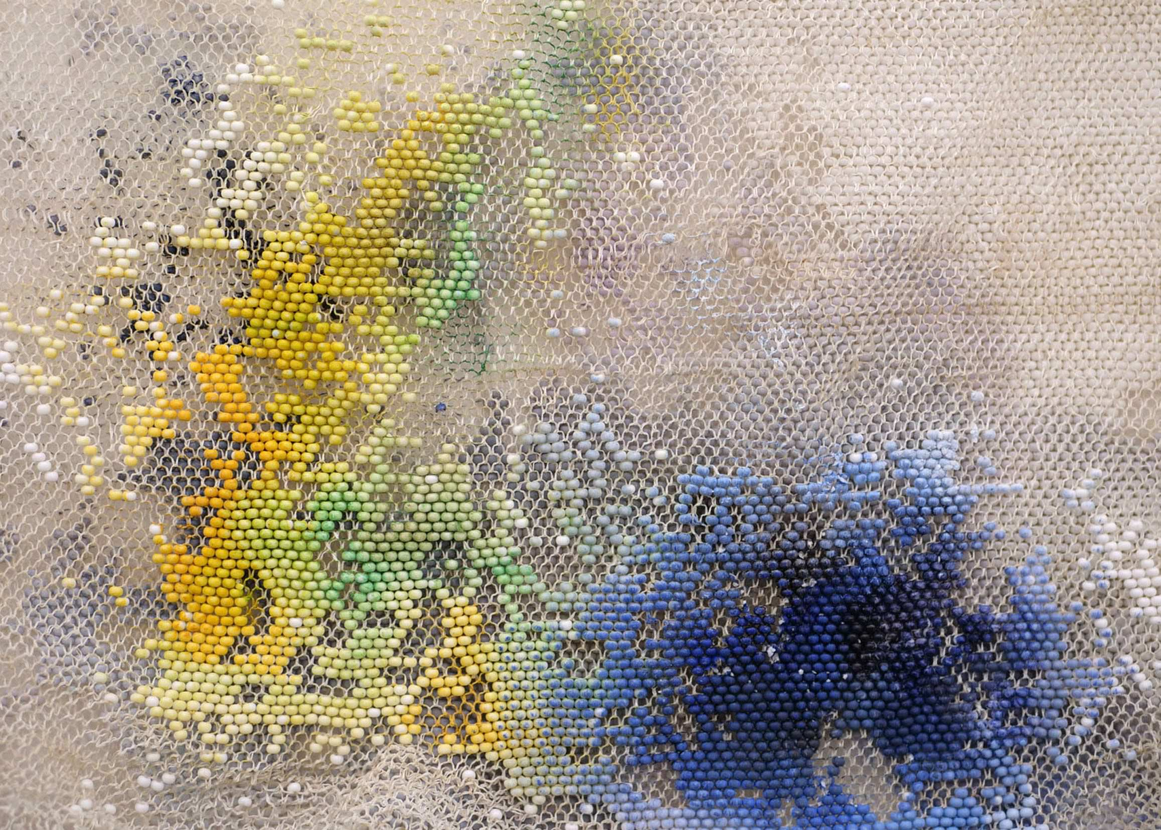 LIZA LOU The Clouds (detail), 2015-2018 site-specific installation of oil paint on woven glass beads and thread on canvas 600 parts, each 35 x 35 cm; Courtesy the artist and Lehmann Maupin, New York, Hong Kong, and Seoul. Photo: Matthew Herrmann
