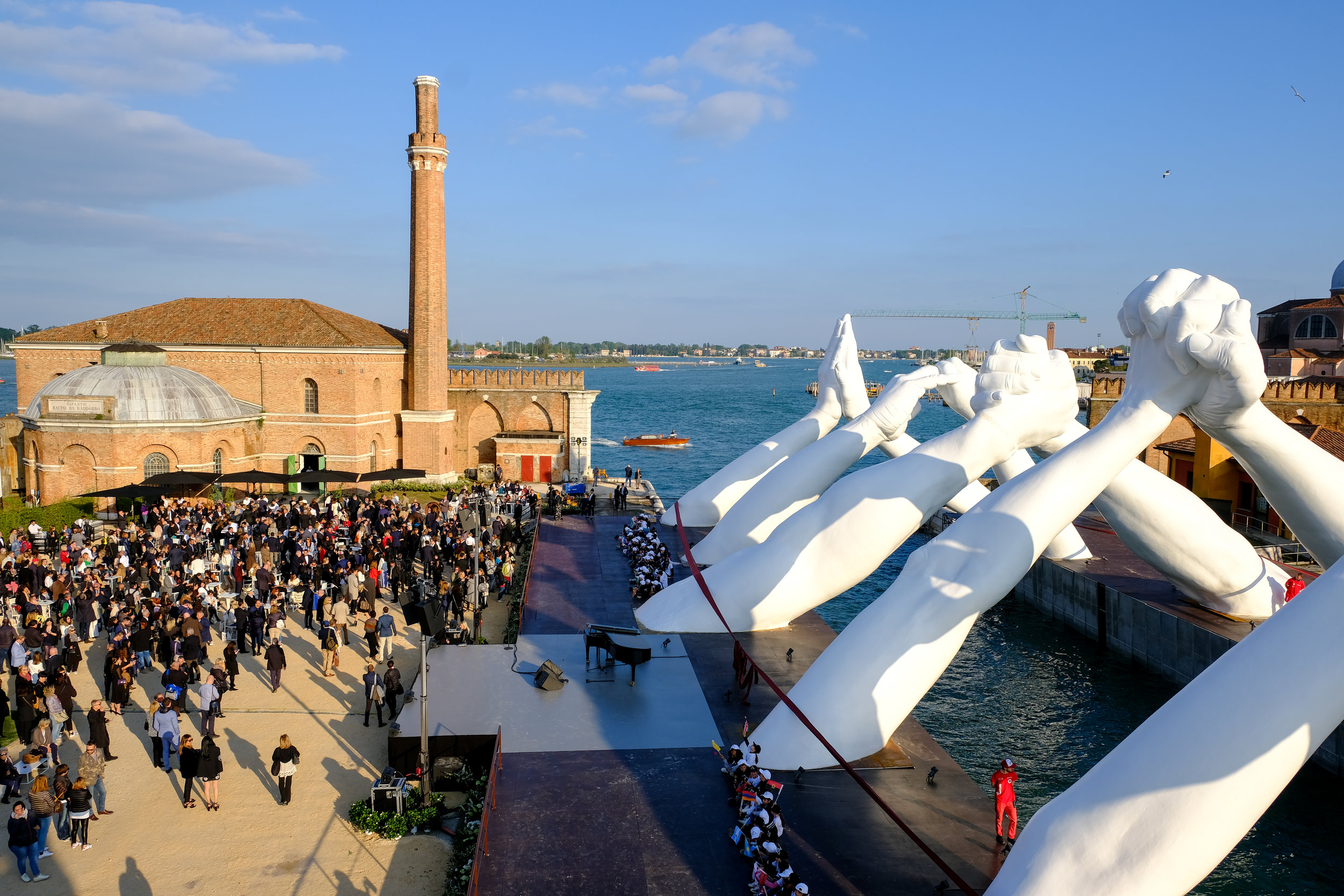 VENICE, ITALY - MAY 09: Lorenzo Quinn's Building Bridges by Halcyon Gallery during Venice Biennale 2019 on May 09, 2019 in Venice, Italy. (Photo by David M. Benett/Dave Benett/Getty Images for Halcyon Art International)