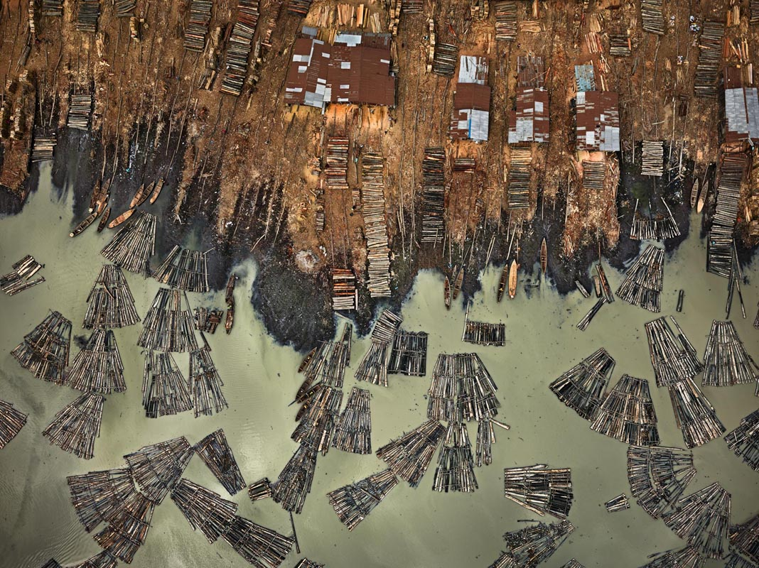 Edward Burtynsky, Saw Mills #1, Lagos, Nigeria 2016. photo © Edward Burtynsky, courtesy Admira Photography, Milan / Nicholas Metivier Gallery, Toronto