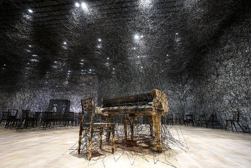 in silence  | 2002/2019 | burnt piano, burnt chair, alcantara black thread | dimensions variable, production support: alcantara s.p.a. | courtesy: kenji taki gallery, nagoya/tokyo. photo by sunhi mang, courtesy of mori art museum, tokyo