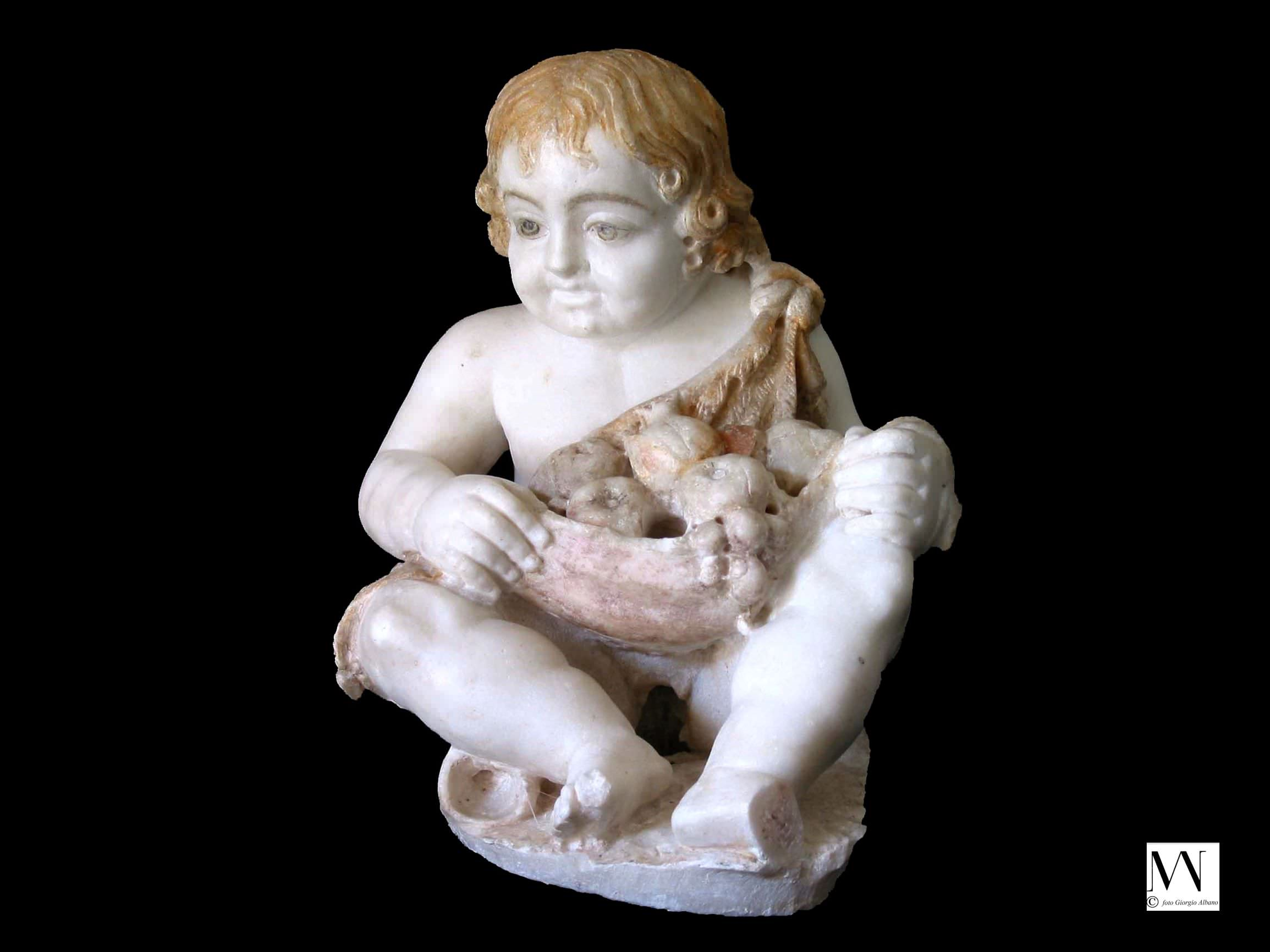 Marble fountain figure of a seated cupid wearing an animal skin filled with fruit, with traces of polychromy surviving, 50 BC–AD 50. Pompeii (26 x 21 cm). Parco Archeologico di Pompeii