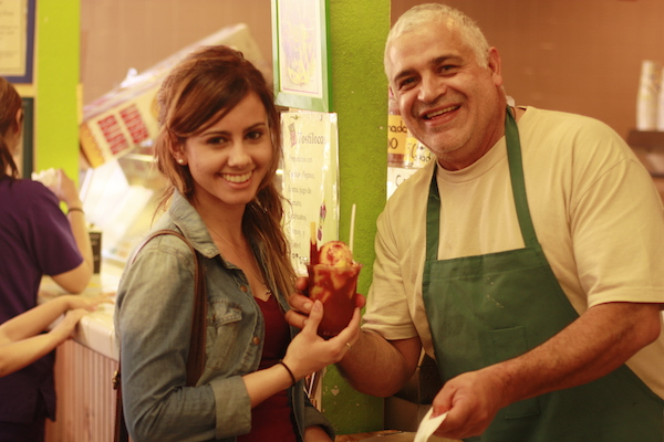 Luis Abundis, Owner of Nieves Cinco de Mayo with a client at his ice cream shop in Fruitvale, Oakland.