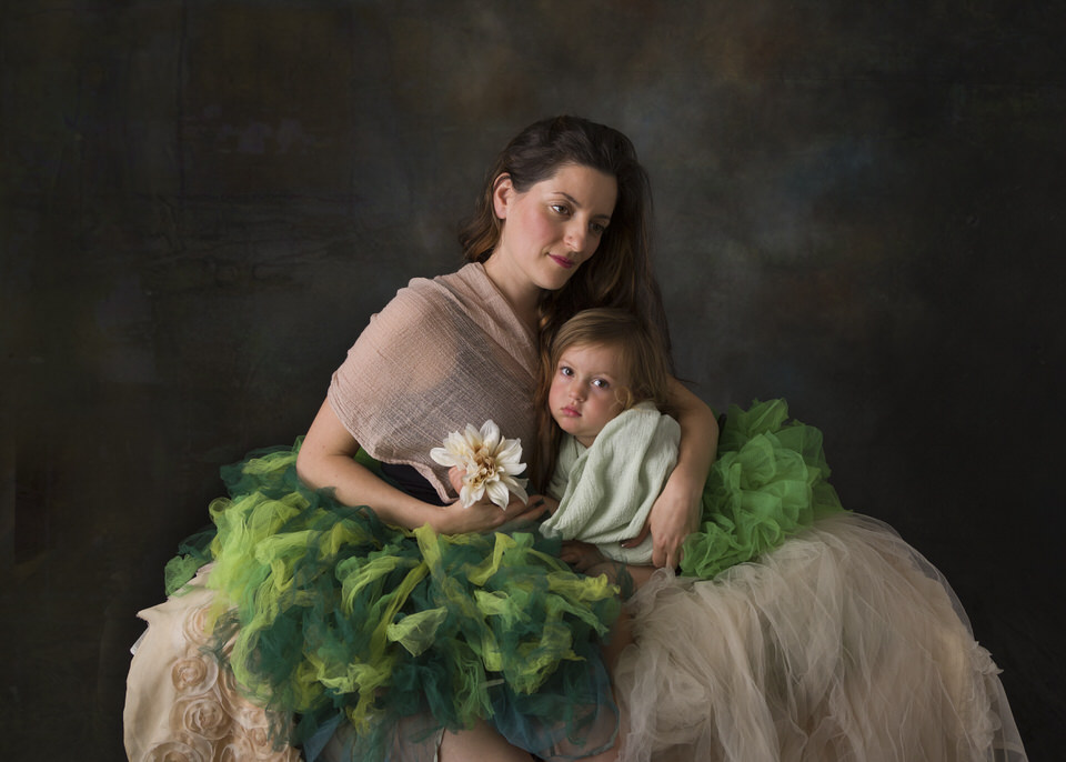 Mother with toddler daughter portrait.
