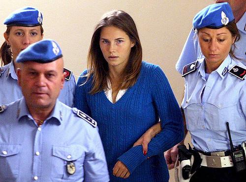 Amanda Knox escorted by Italian police.