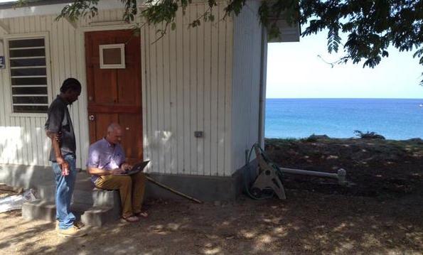 Will McClintock conducting an interview at Carr's Bay. Photo credit Robin Ramdeen.