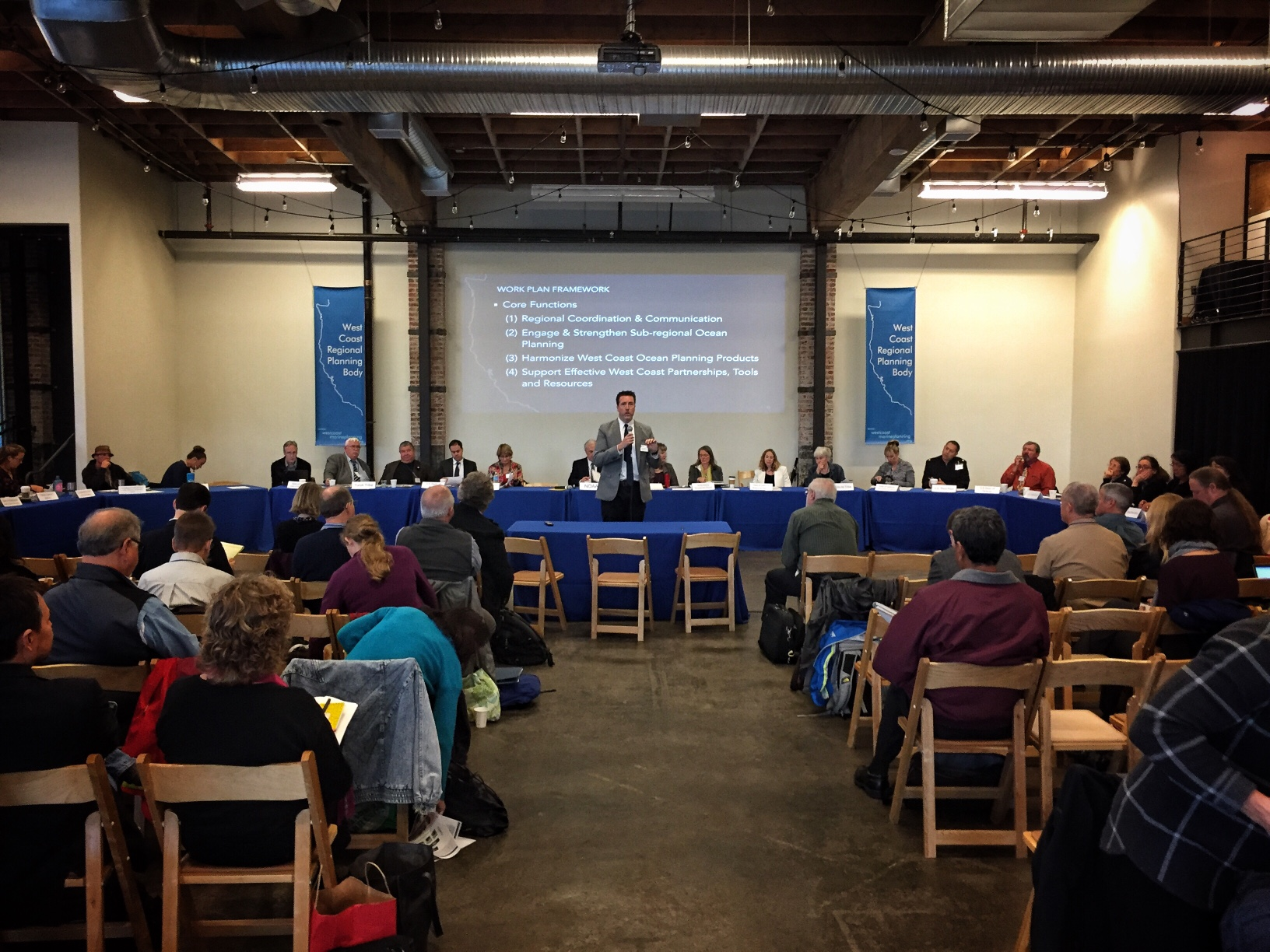 John Hansen, marine planning coordinator, addresses attendees at the west coast regional planning body meeting, Portland, OR. The WCRPB is seated behind him.