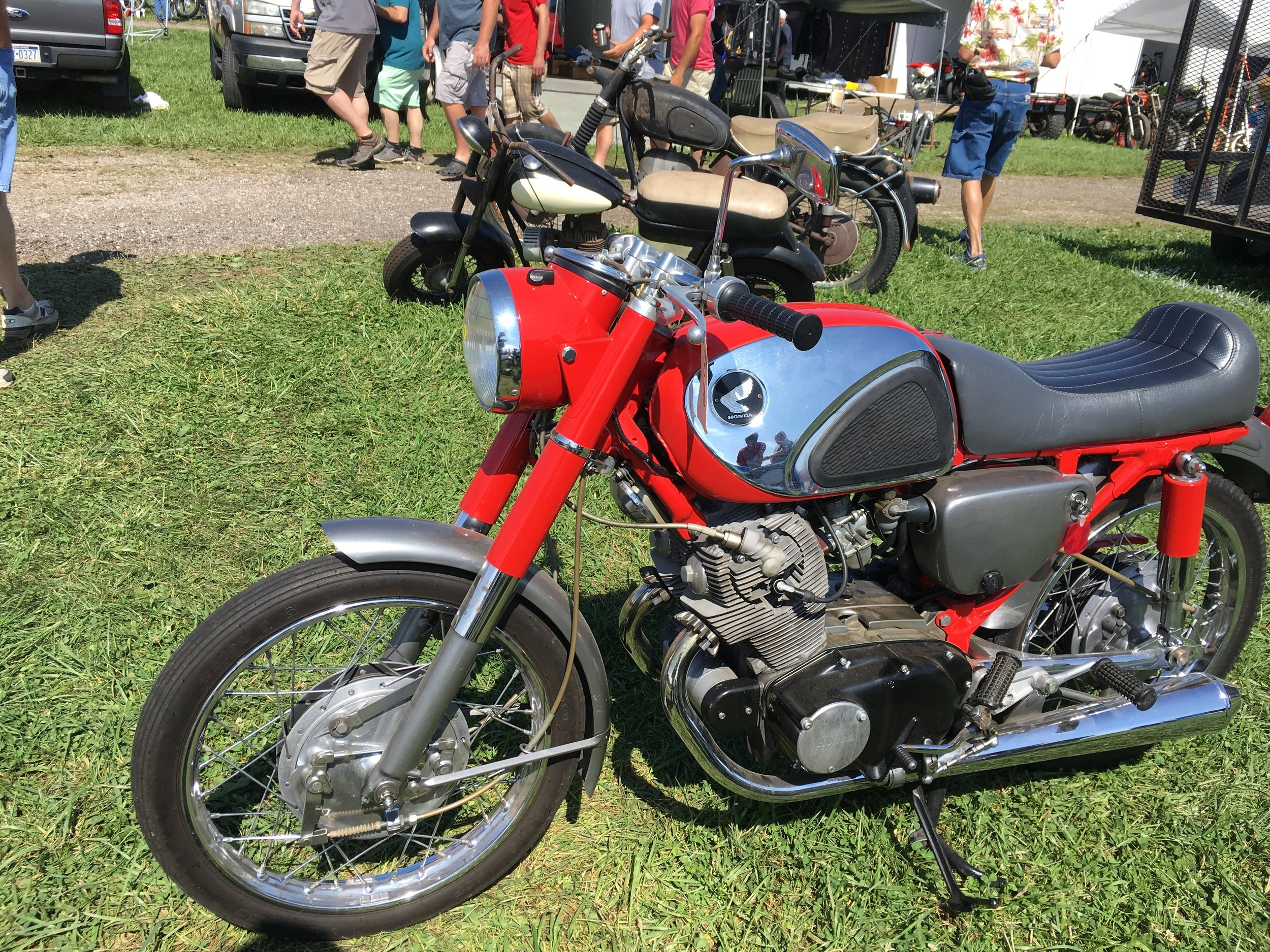 "A beautiful Honda 305. Thinking this is an early sixties CB77. The passenger peg mounts are the same as the rear-set mounts on the ""Cabracer 360"" and ""The Seven"" bikes."