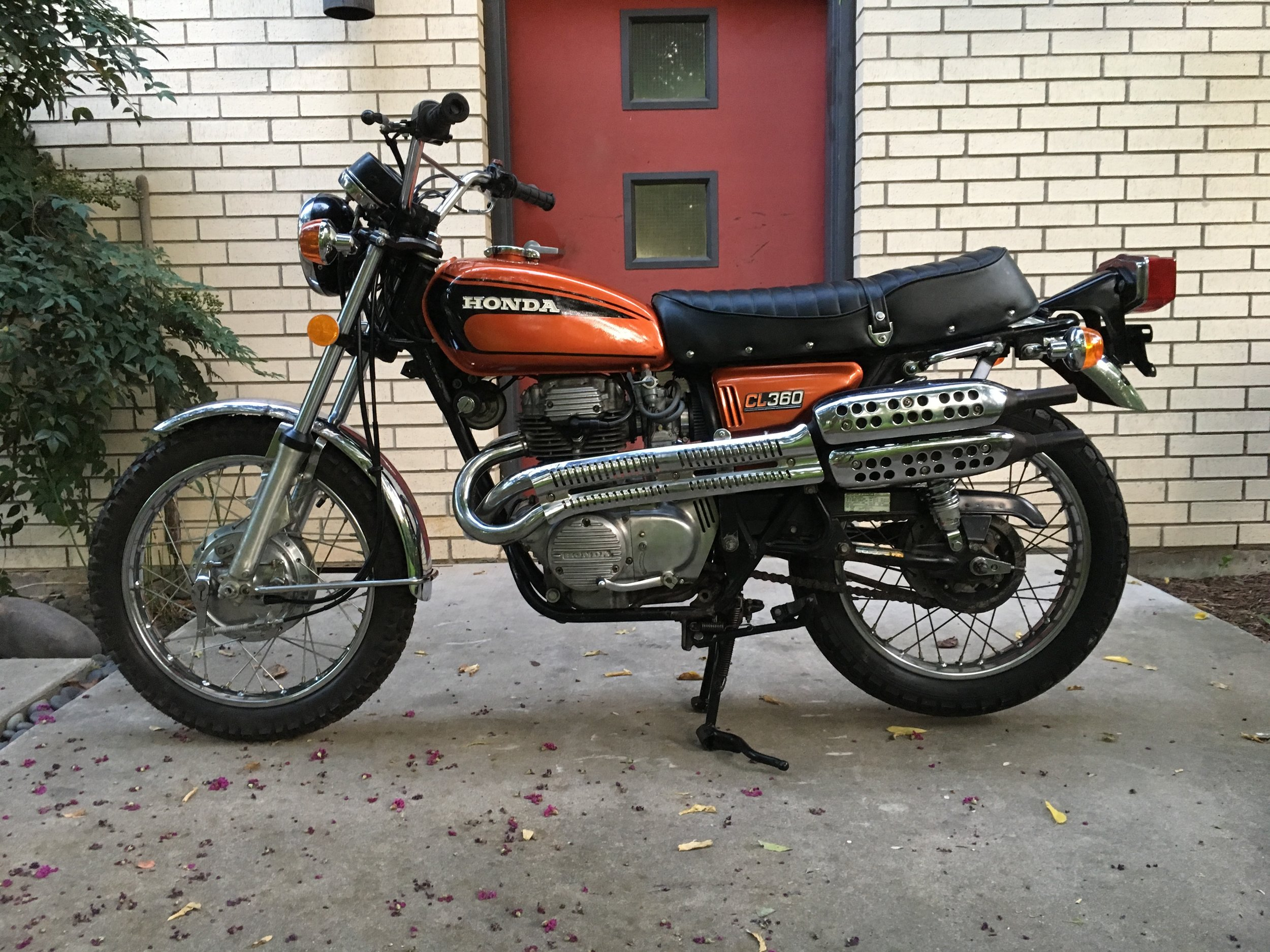 A 1975 Honda CL360 that came to the shop in storage bins. There were a number of NOS parts used to restore this beautiful survivor. A set of Mikuni VM30 carbs and pod filters replaced the original Keihin's, but the bike is otherwise stock. This bike is being prepared for a potential customer.