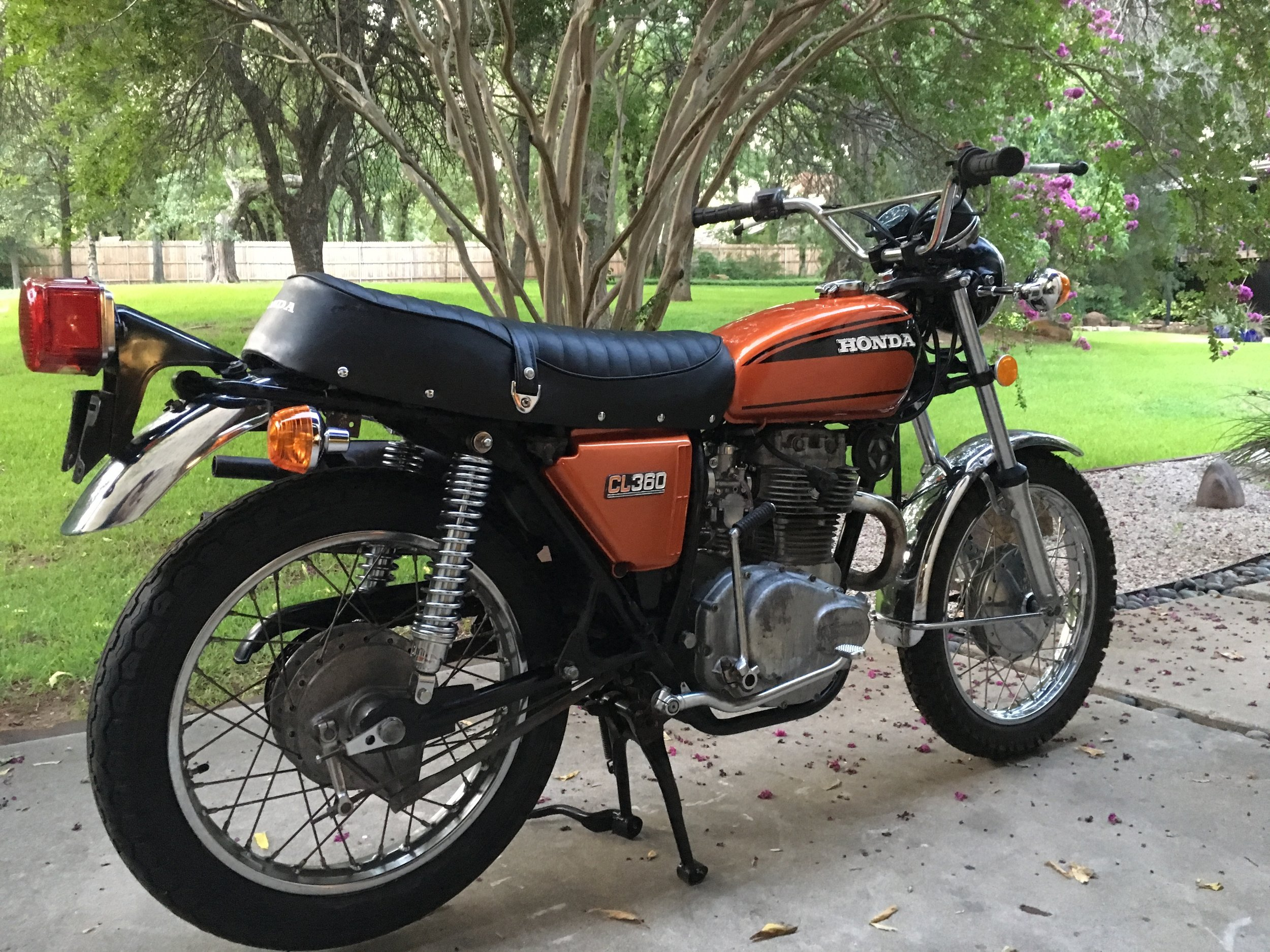 A vintage set of Japanese Redwing shocks replaced the rusted originals. A new seat cover, grab bar, turn signals,  and a taillight lens have the rear-end looking fresh. The bike came without  front or back footpegs. Some replacements are on order.