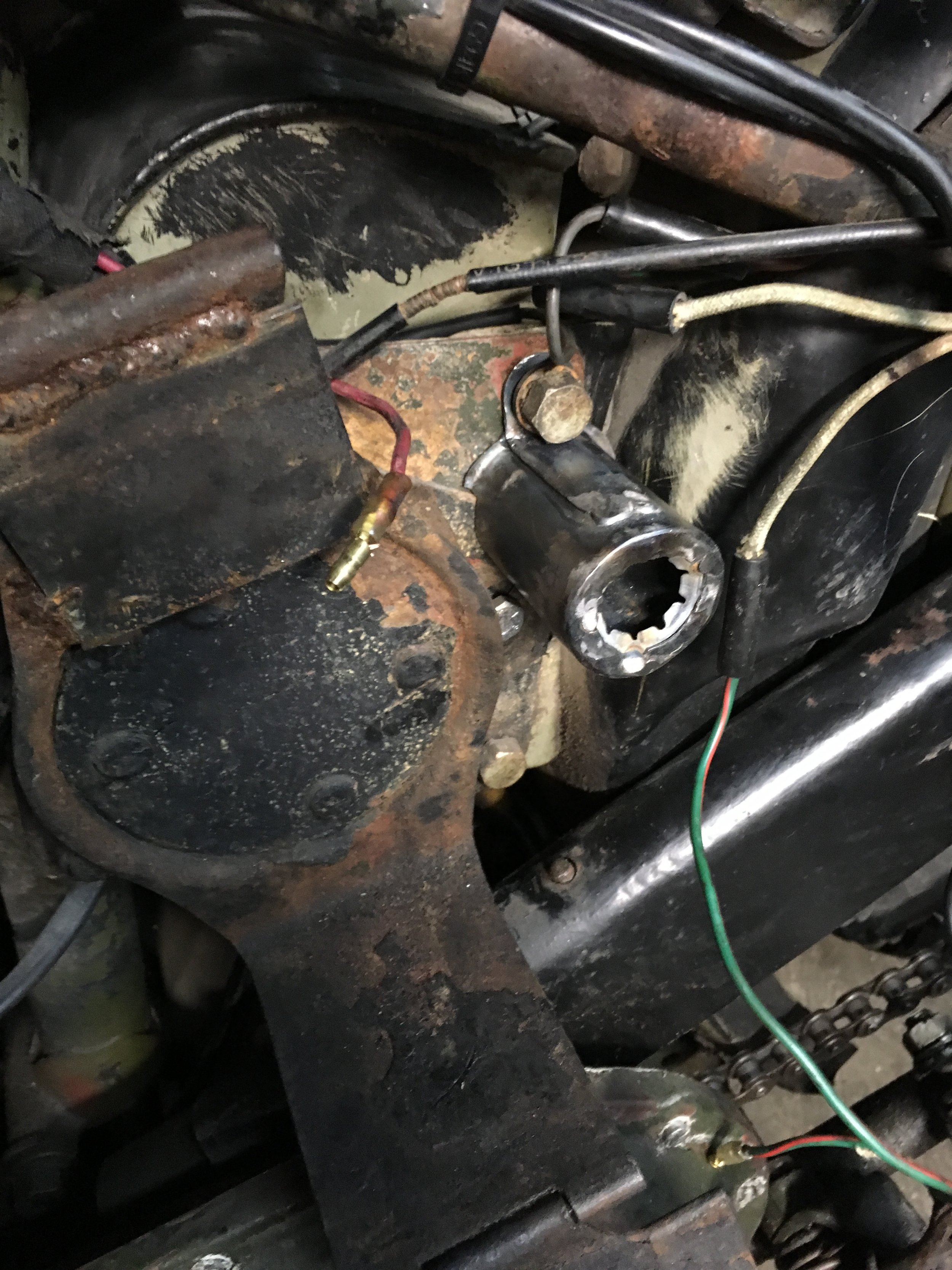 A small cylinder was fabbed up from 22 gauge steel to hold the battery disconnect switch. An existing bolt was used to mount it behind the battery box.