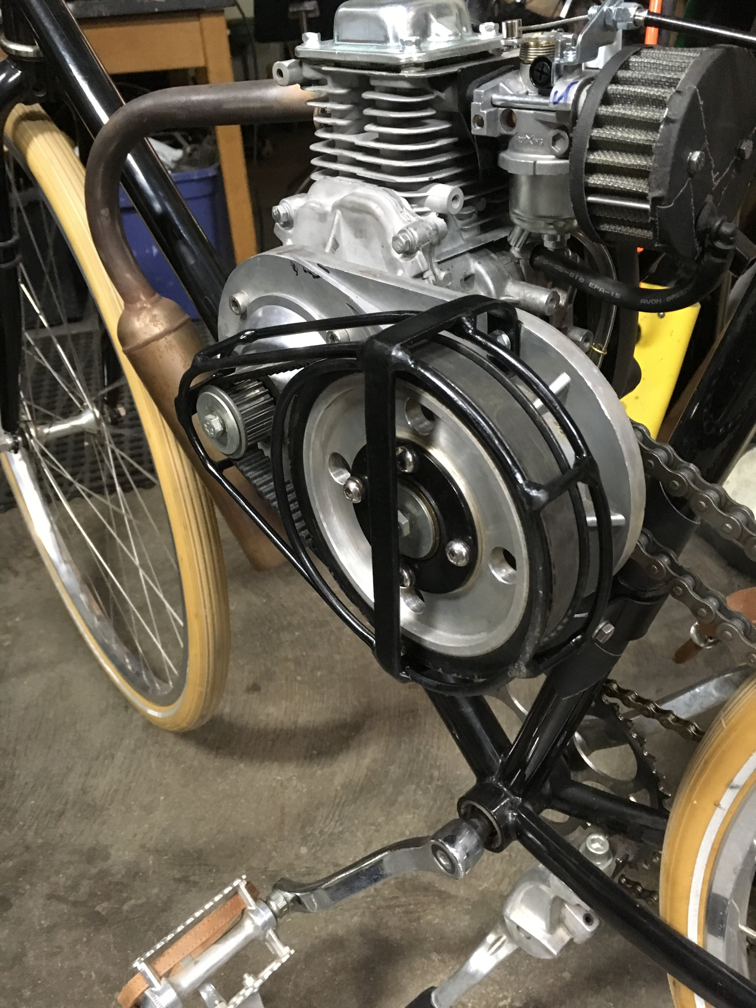 The guard mounted up. When I first test rode the bike, my leg contacted the exposed pulley, prompting this mod.