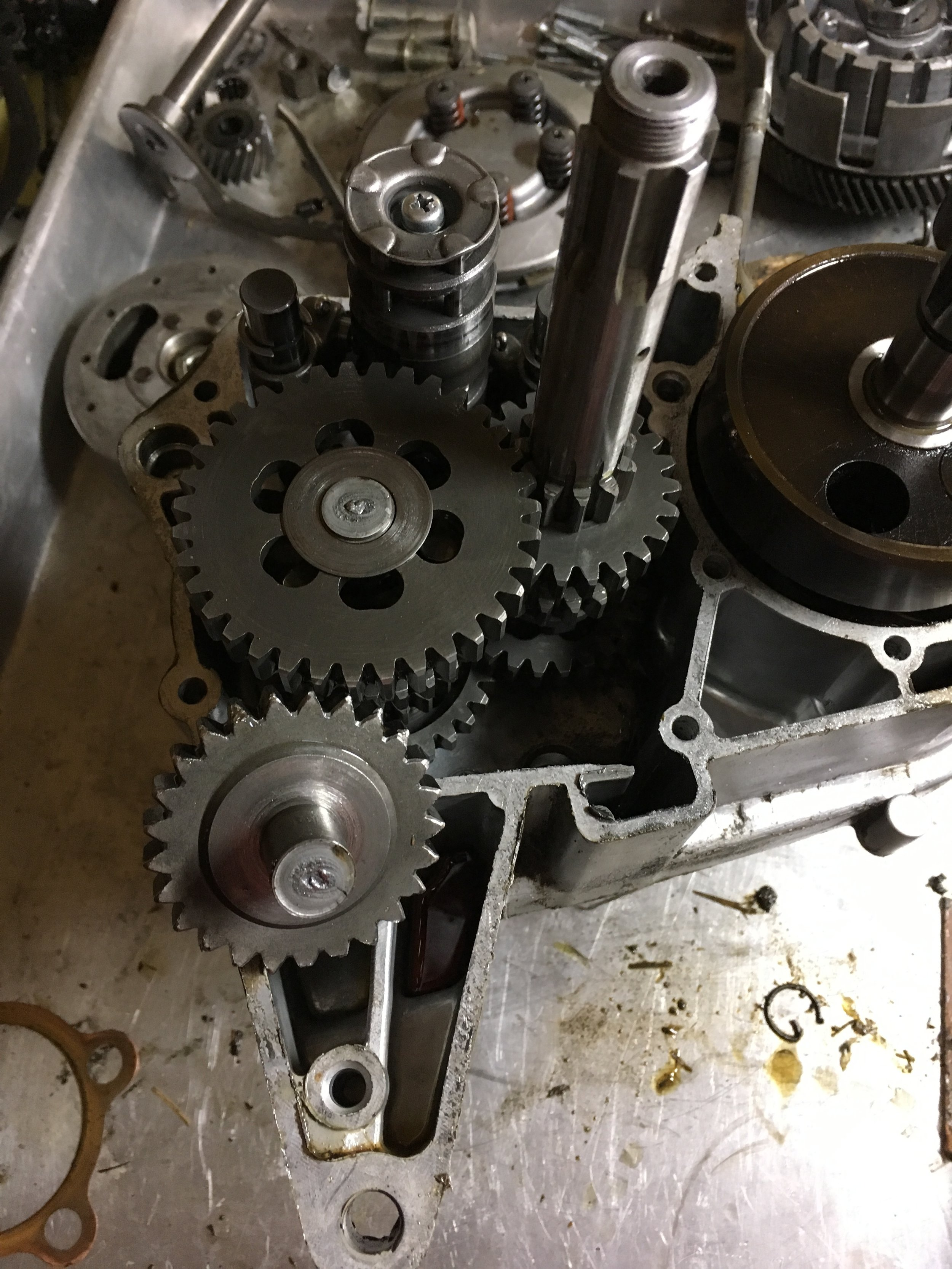 Some of the carnage inside the 1973 Yamaha CT-3. Apparently the bike was wrecked during an errant wheelie. My guess is that the kickstart was jammed on while the engine was revved, shearing off the gear and end of the output shaft. The sheared tranny shaft gear normally lies between the primary shaft of the tranny and the kickstart gear. A coming parts engine will hopefully have intact replacements.