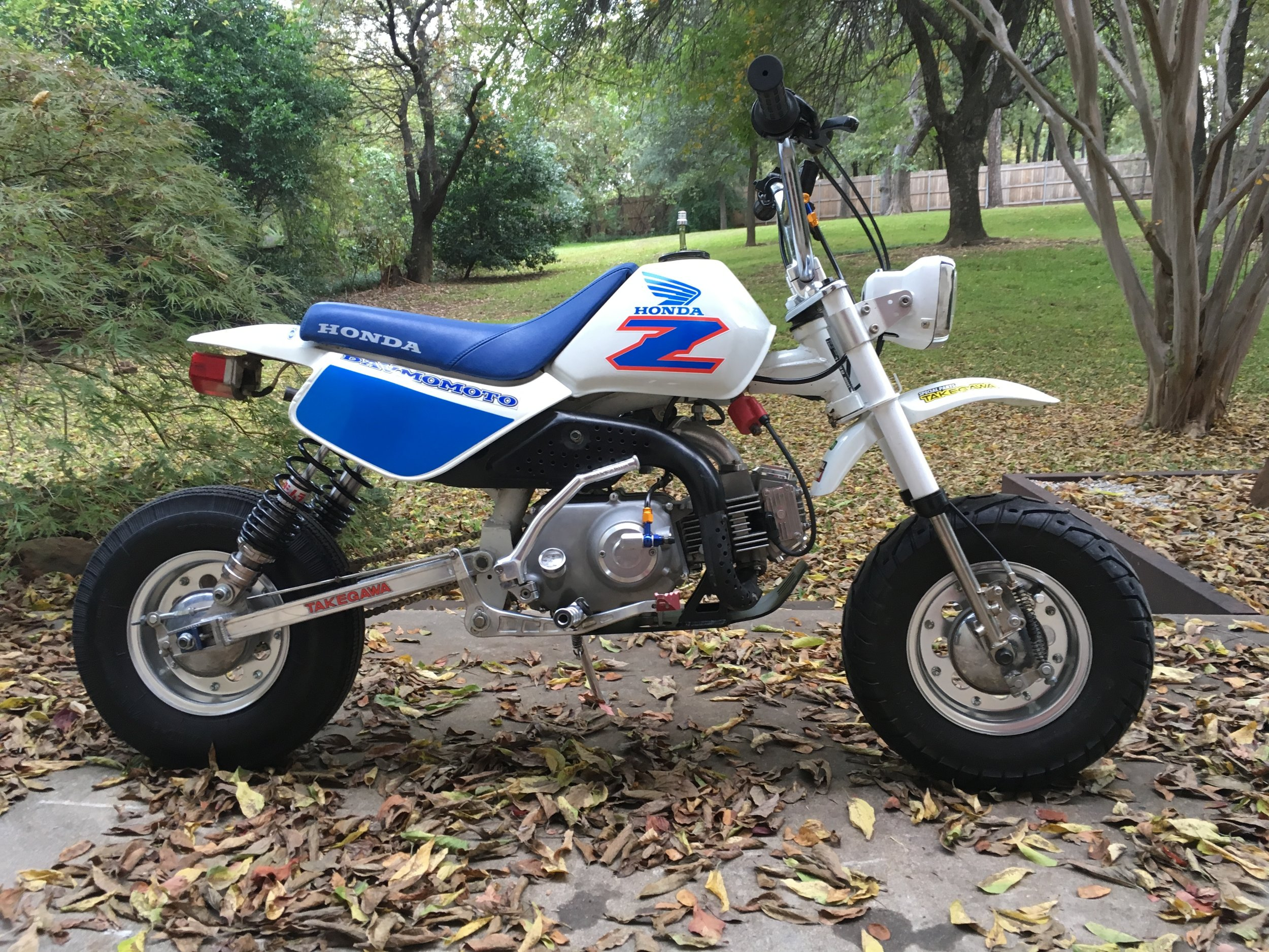 "Some changes on the 1999 Honda Z-50 ""Hater"" bike since the July post. A heavy-duty manual clutch and Takegawa hydraulic clutch actuator, a freshly repainted tank with the underside reformed to accommodate the Mikuni VM26 carb, and fresh graphics for the whole bike were some of the changes."