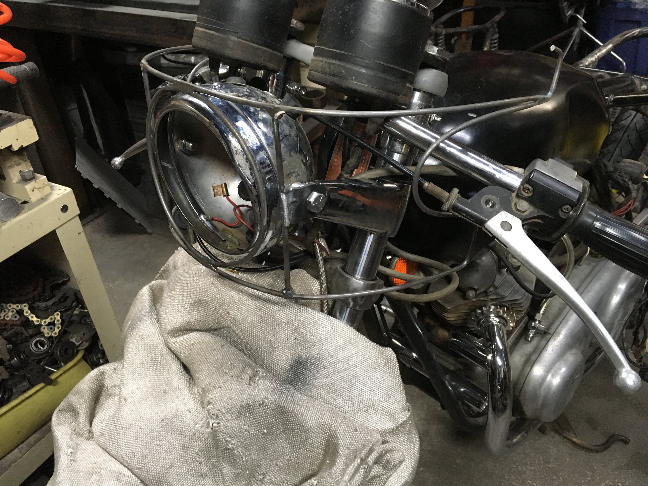 The wire form for the fairing is being worked out here. There is a little dance you have to do between the gauges, headlight, forks, bars, and controls…and it should look good too, by the way.