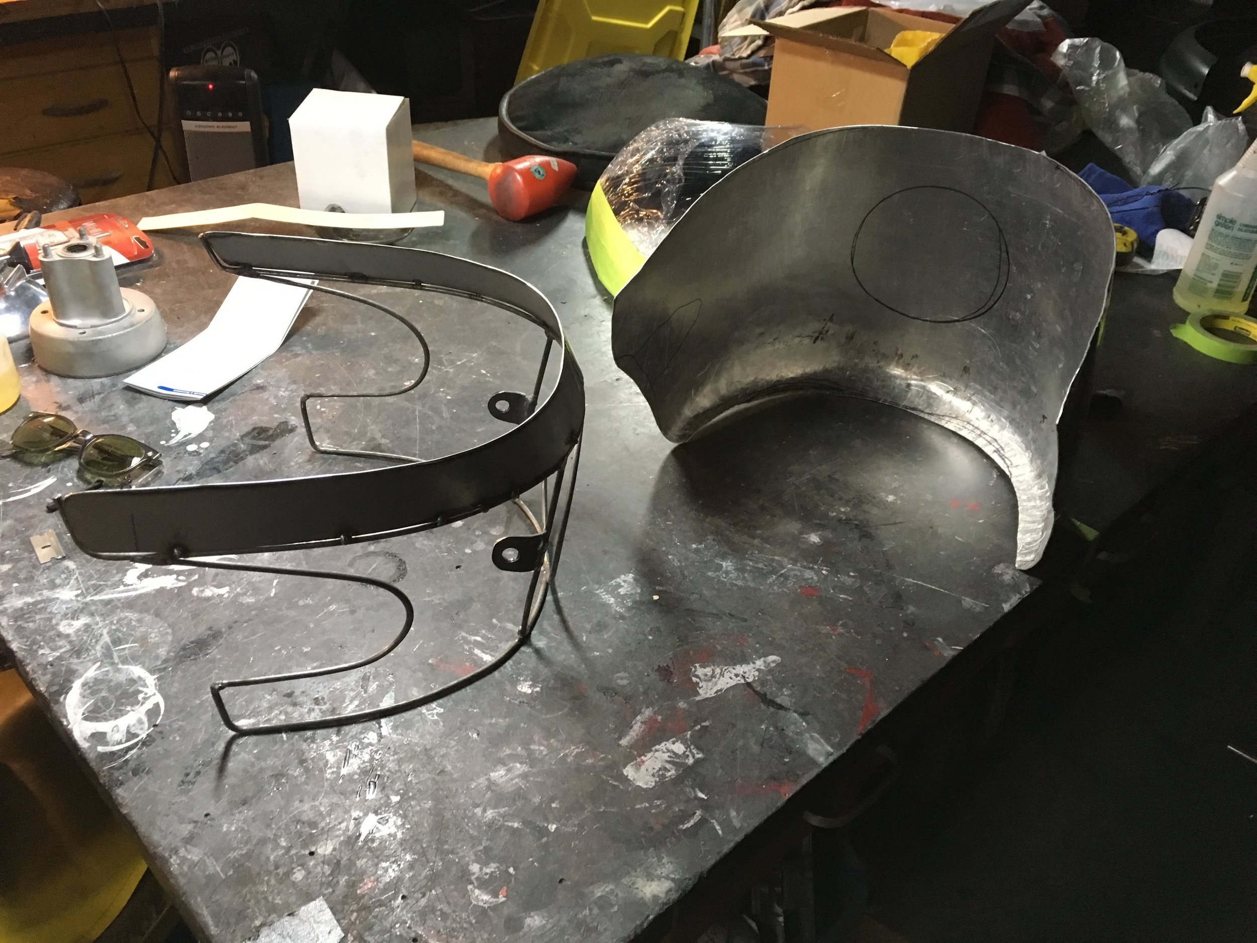"""Working on a front fairing for the 1974 Norton Commando cafe build. The skin is .050 aluminum, with a 3/16""""steel wire frame. My process is somewhat backwards in that I usually start shaping the skin first and work on the wireframe after. This is the same basic technique I used on """"The 7"""" bike fairing."""