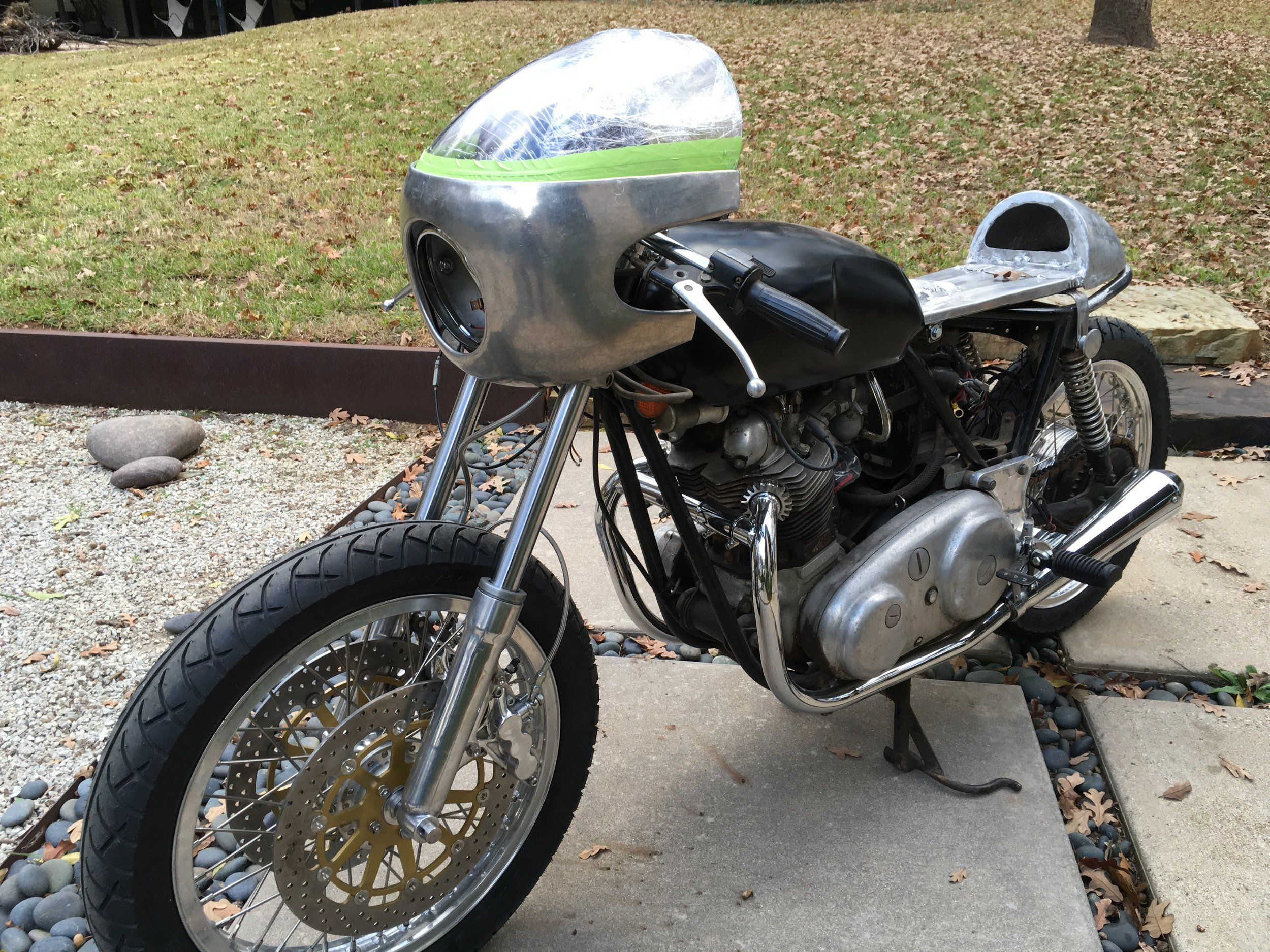 Just rolling out the 1974 Norton Commando with the fairing mounted for the first time.