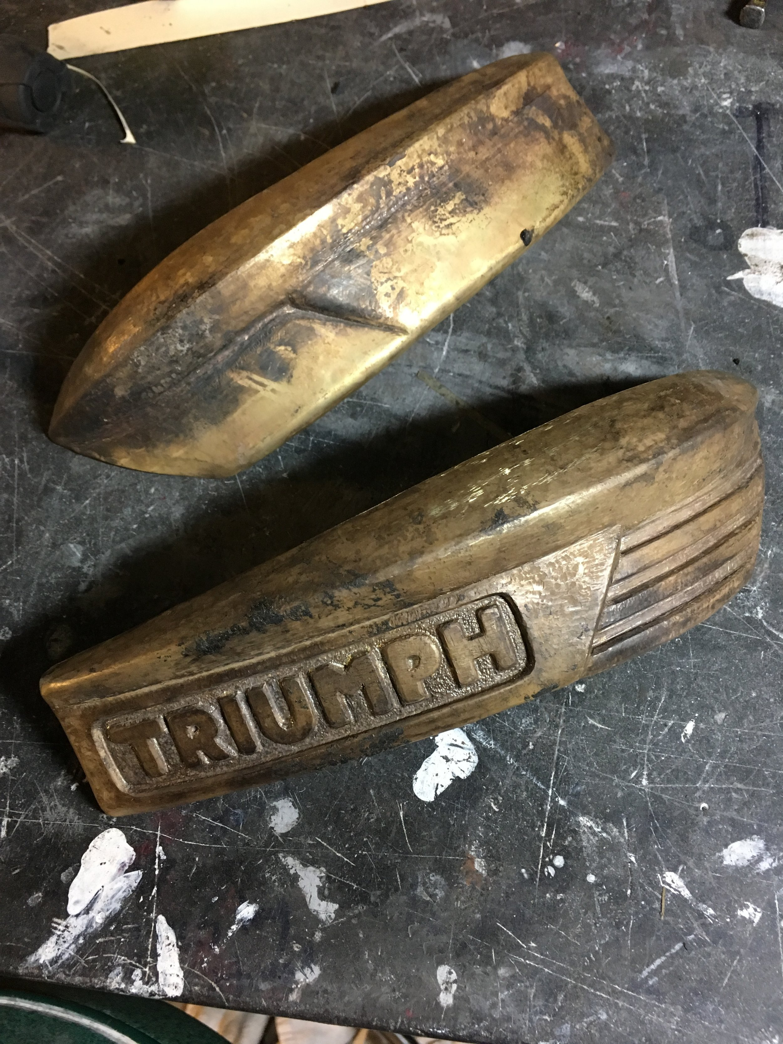 Over fifty hours in the pair at this point. There will be some more detailing on the right badge, mostly texturing the surfaces. Still trying to decide whether to go with a hammered or sanded and polished finish. There is a good chance the dark coloring will be used to match a number of other brass part regardless of which surface treatment is used..