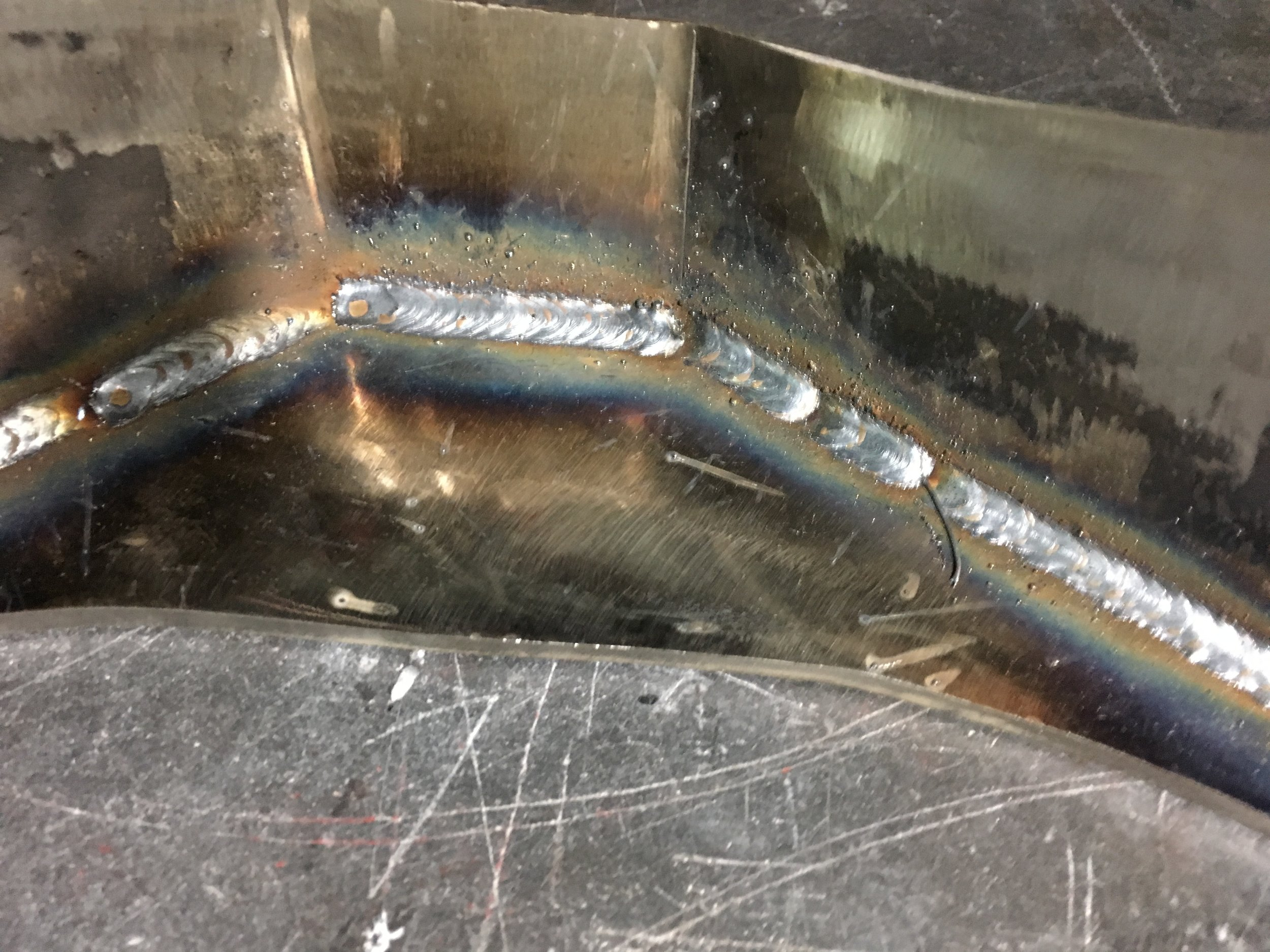 Decent welds. Too bad they are inside the brace where they will never be seen.
