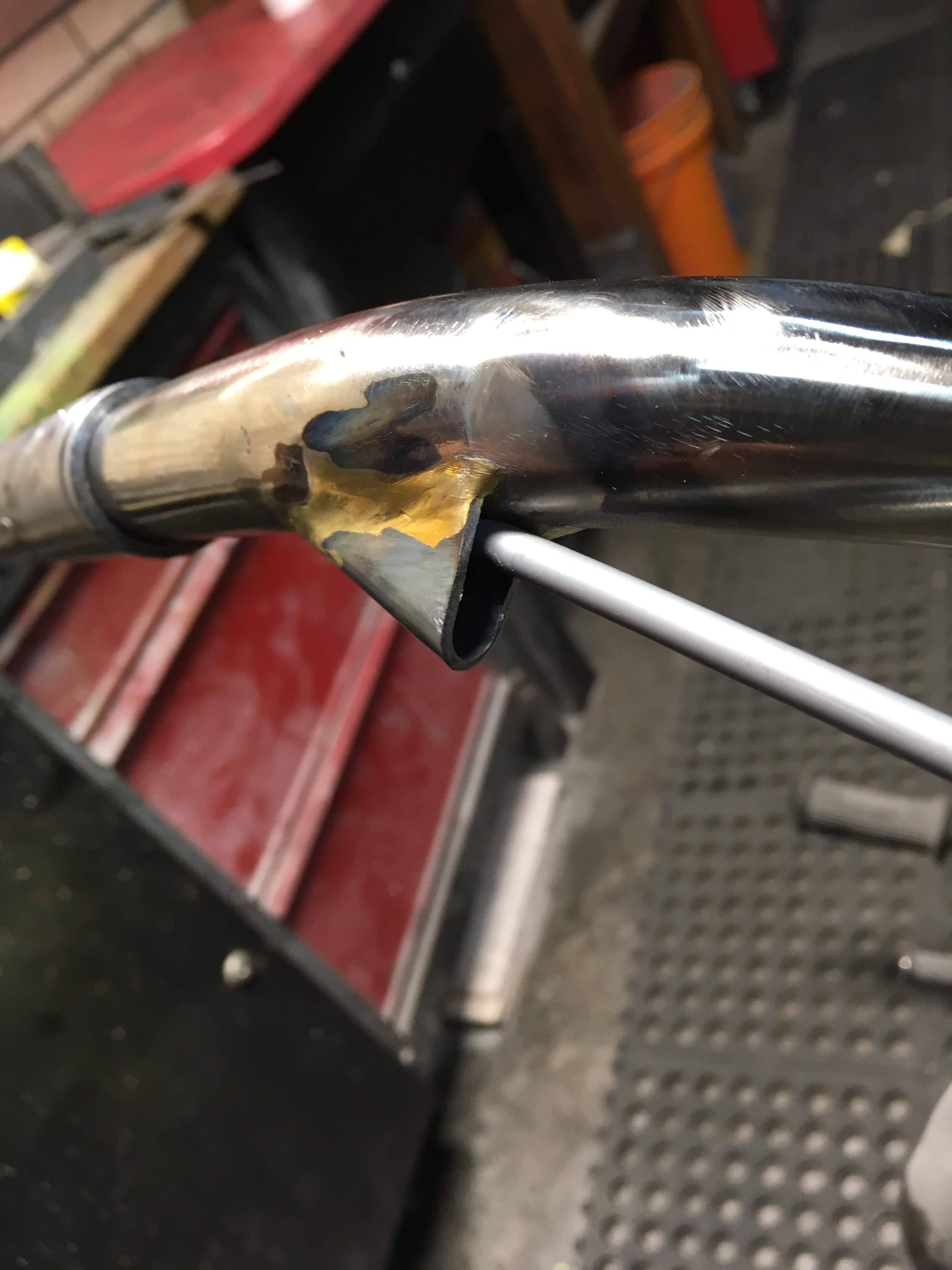 Because there are two cables exiting the handlebars on the right side and they are not as fat as the left-side clutch cable, a thinner, taller shroud was made.
