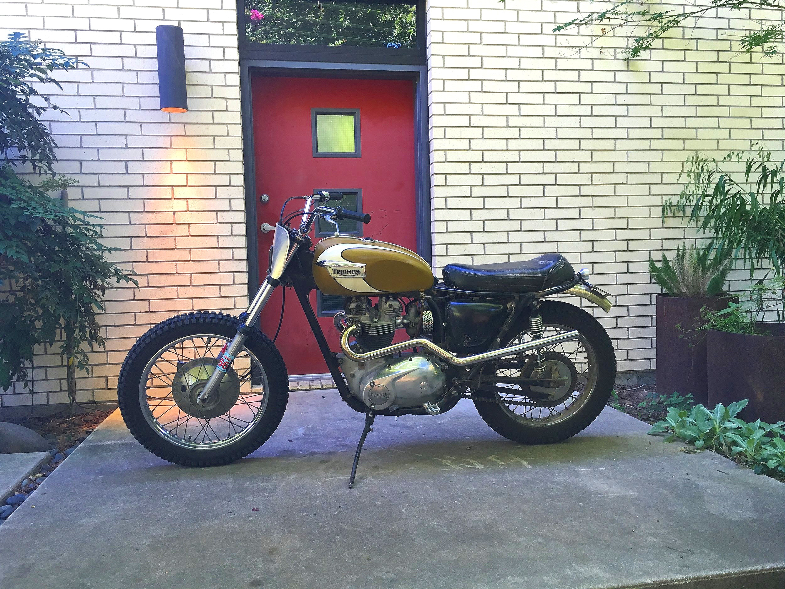 "Jason Lee's 1971 Triumph TR6C desert sled, ""Goldie""came to the shop with no spark. A rapid battery discharge indicated there was a parasitic drain. The tail light would come on randomly when the bike was parked, and no amount of adjustment to the brake switches seemed to make any difference."