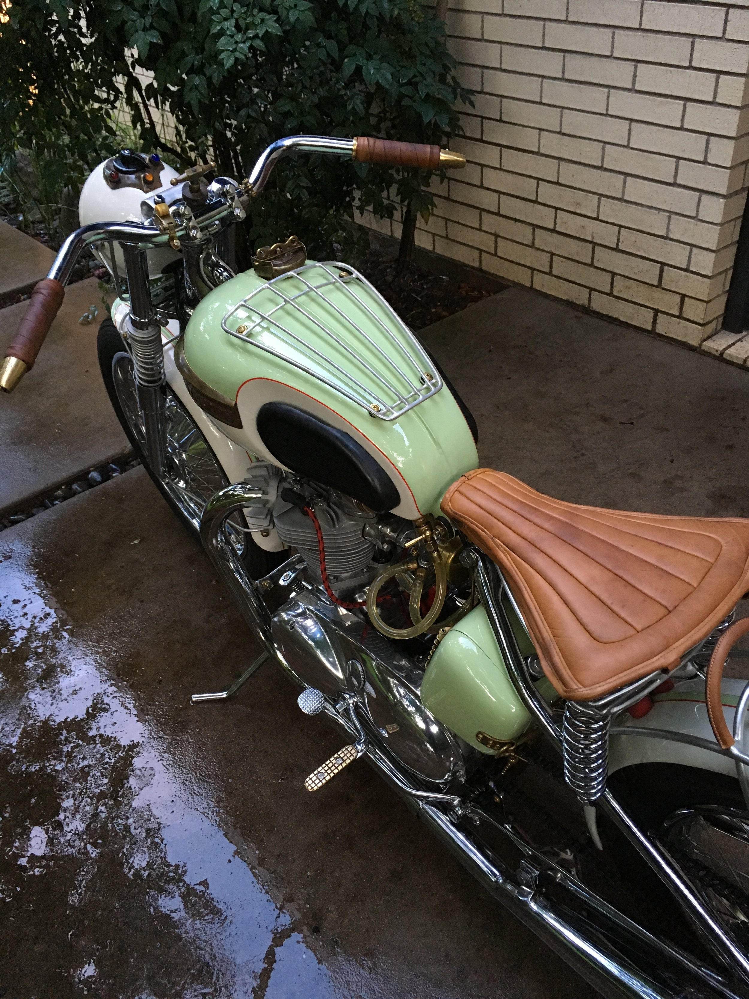 I got a couple drops of motor oil on the seat, but they just add character. Some leather balm purchased at Wilkinson TX, a local leather artist store, has it looking and feeling supple.