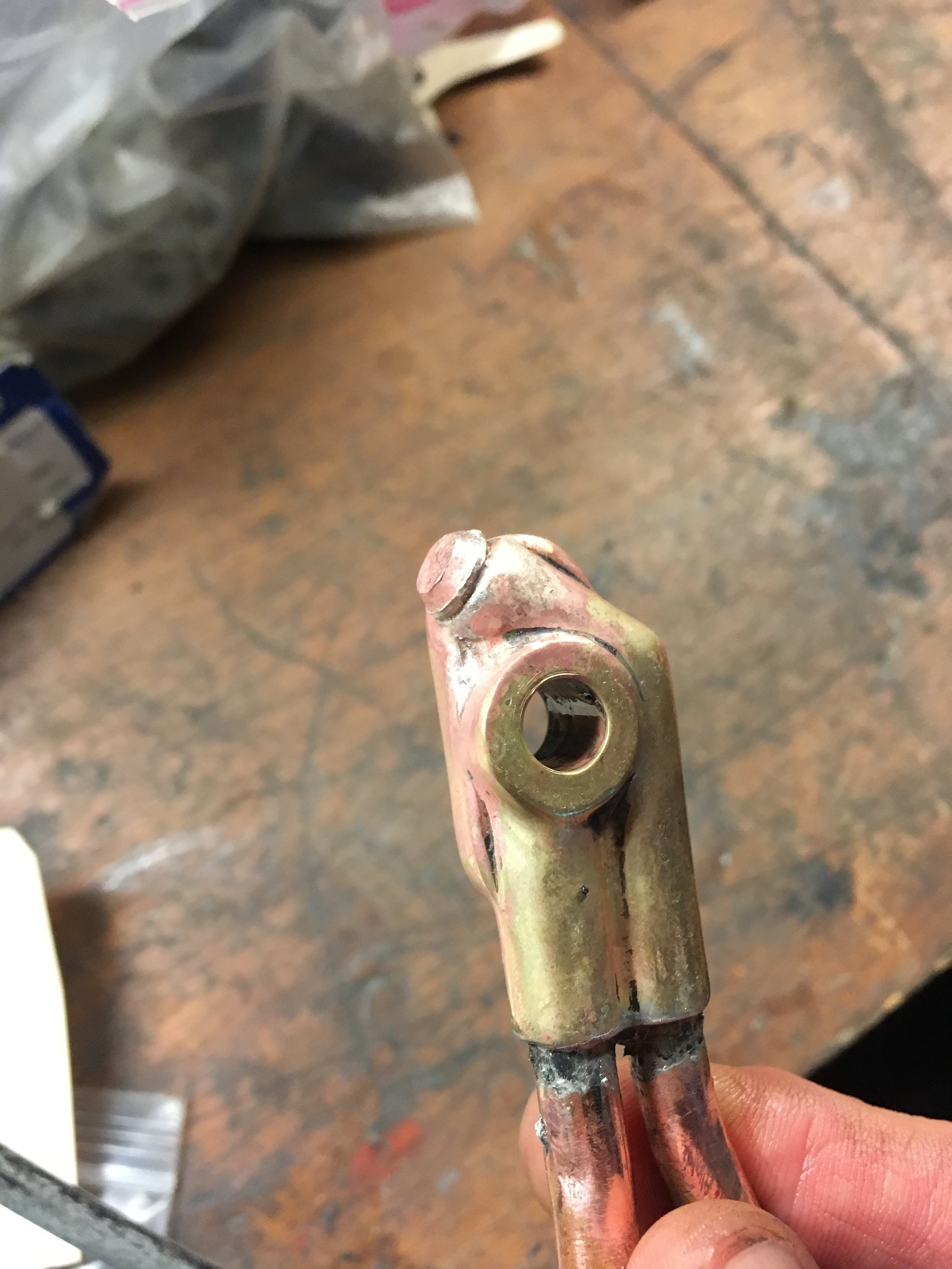 Here a brass plug was turned and press-fitted into the bore, and then silver-soldered to secure it. The copper tubes are lead-soldered in place and had to be re-done after the plug was put in. It does not leak and will stay in place till the next owner grinds it away.