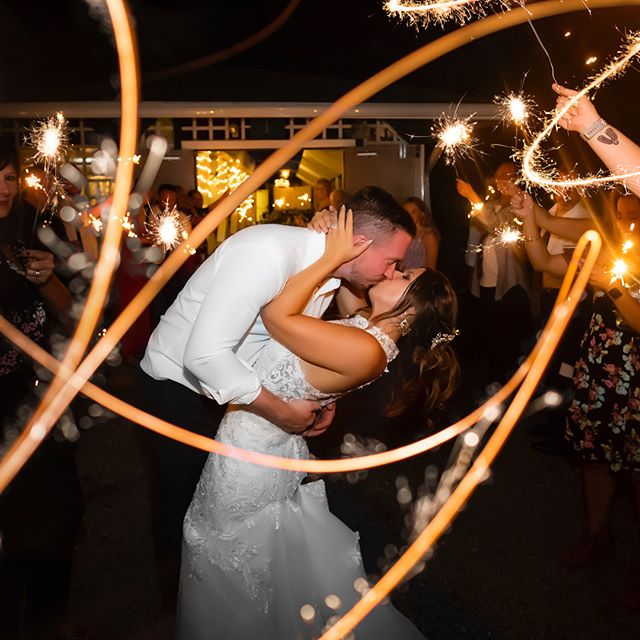 "A MIGHTY flame followed a spark of love with these two love birds 😍 I can't explain how much fun I had during Dan and Kaylie's absolutely stunning Wedding Day at Windber Recreation Park in Windber, PA. From the beautiful ceremony in Kaylie's childhood back yard all the way to the sparkler send off after their reception was ending…this was an AMAZING DAY! It was next to impossible to decide which photograph to share from their wedding but I felt we should start the photos off with how we ended the day 💥 It is always amazing seeing the bride and groom's family and friends surround the couple at the end of the night and shower them with love after these send off 😊 I'm seriously IN LOVE with this one 😍 I can't wait to share more photographs from their beautiful Wedding Day — you know what to do…stay locked here for more photographs from Dan and Kaylie's Wedding Day.⁣ ⁣⁣ ⁣Want to make sure you see all of my Wedding, Engagement, Family, Children's, High School Senior and Landscape photographs?! Head over to my website (http://www.jasonbafilephotography.com/) and sign up for the Mailing List. You can also "" L I K E "" @JasonBafilePhotography on Facebook & Instagram to keep up to date with me! I hope you decide to join our community & the conversation on all of the photographs, it means the world to me. Thanks everyone 👌🏽"