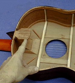 """Here we see the """"Spanish Foot"""" inside of an assembled guitar."""