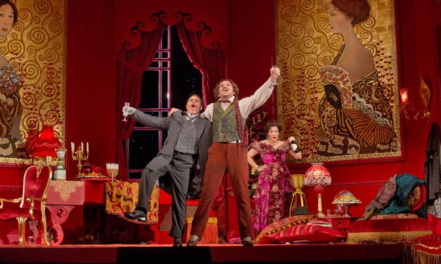 Patrick Carfizzi as Frank, Michael Fabiano as Alfred and Susanna Phillips as Rosalinde in Strauss' Die Fledermaus. Photo by Ken Howard/ Metropolitan Opera.