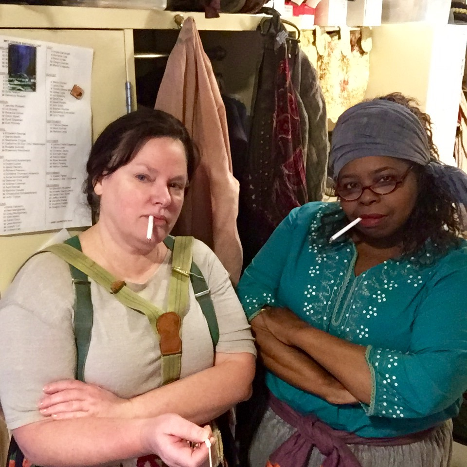 Two of the ladies of the chorus, Rebecca Carvin and Marvis Martin, getting into character (The cigarettes are fake don't worry!)