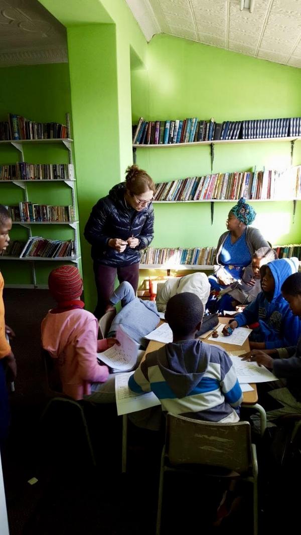 Pat Steiner, tutoring 5Cees children in math and English.