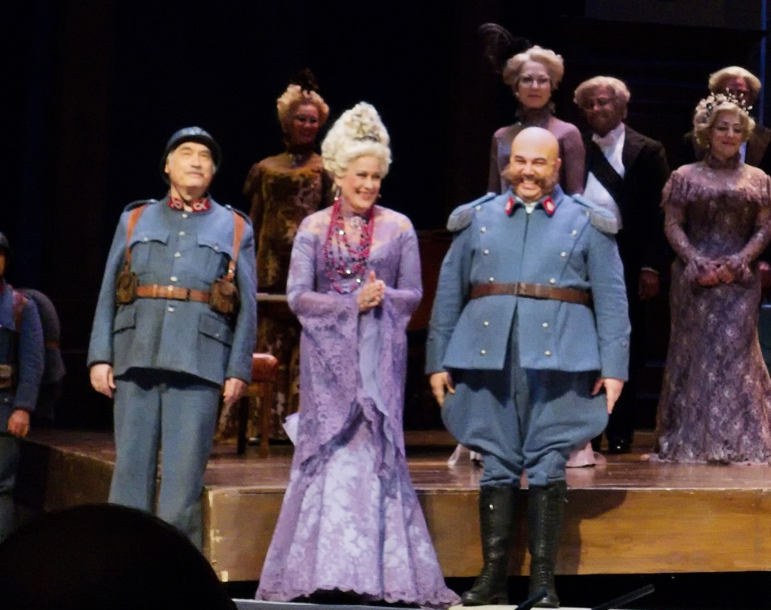 Roger (on the left) during a curtain call for  La fille du regiment .