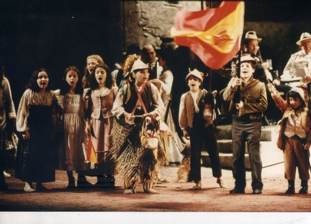 Bryan (center, on the horse) in the 1996-97 Zeffirelli production of Carmen.