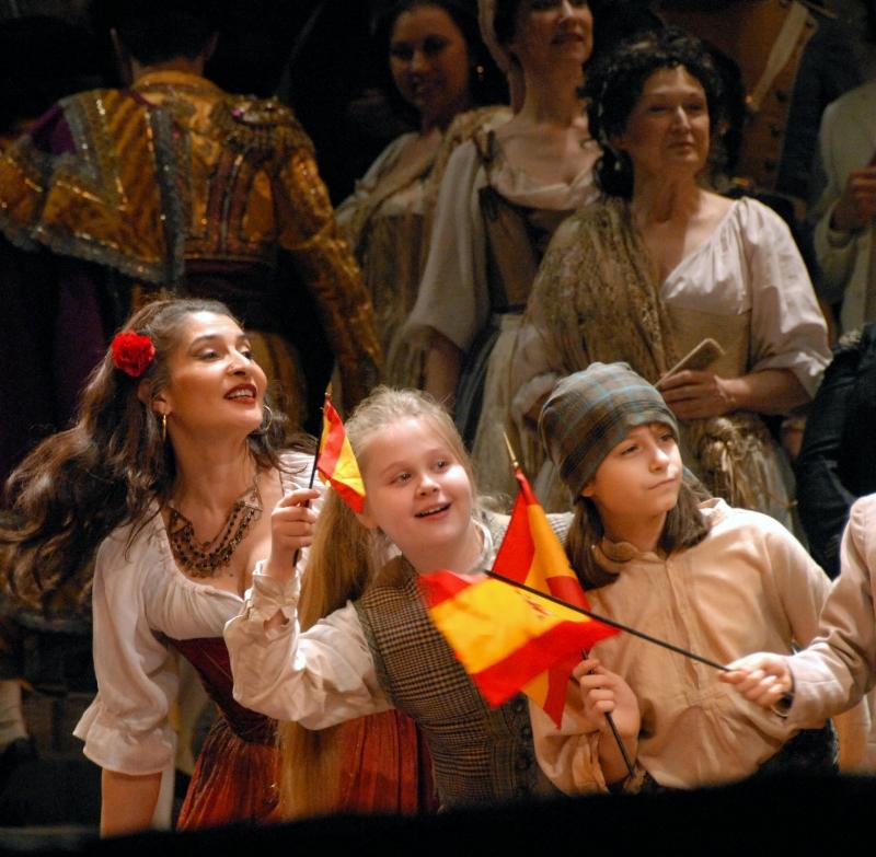 "Melanie Spector (center) enjoying the parade in a production of ""Carmen"". (Photo: Susan Spector)"