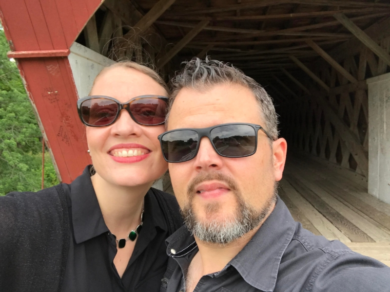 Hester and Greg taking a selfie in front of the Bridges of Madison County!