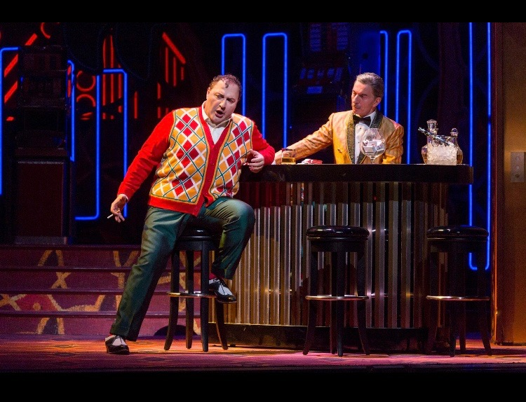 Frank as the casino bartender., with George Gagnidze as Rigoletto. (Photo: Richard Termine)