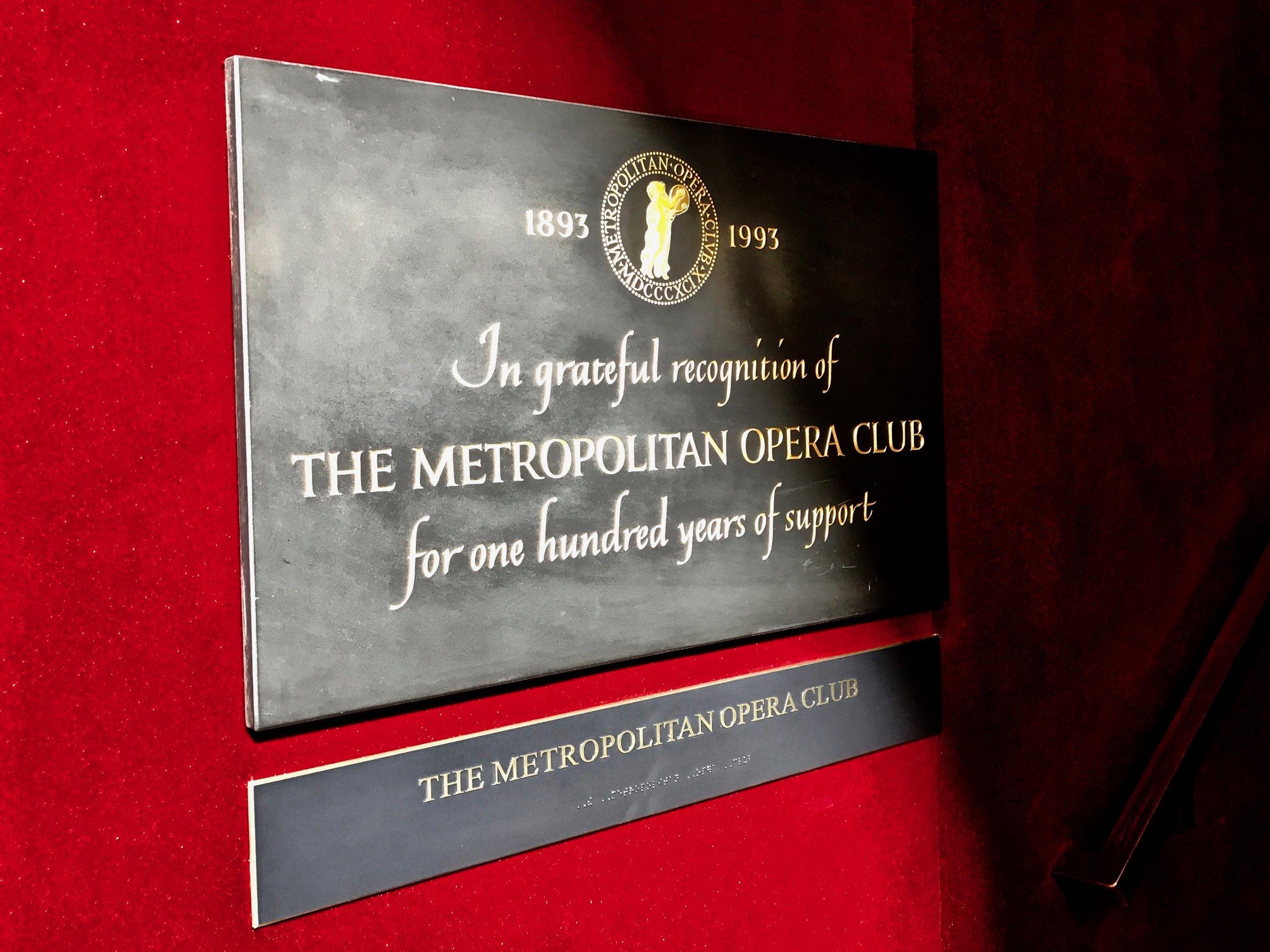 The plaque that greets you as you enter the Metropolitan Opera Club space. (Photo: Daniel Clark Smith)