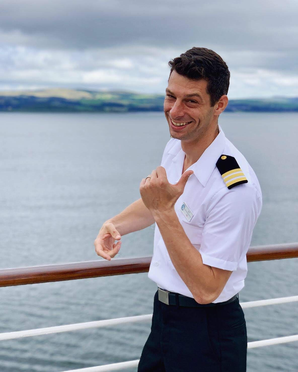 Is that Sharpless? No… just chorister Ned Hanlon in uniform as Assistant Cruise Director of the Azamara Journey.